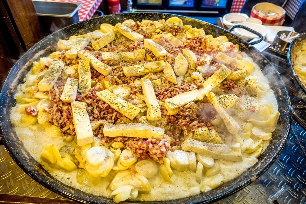 Pan of tartiflette, a mix of potatoes, onions, lardons, cheese, and wine