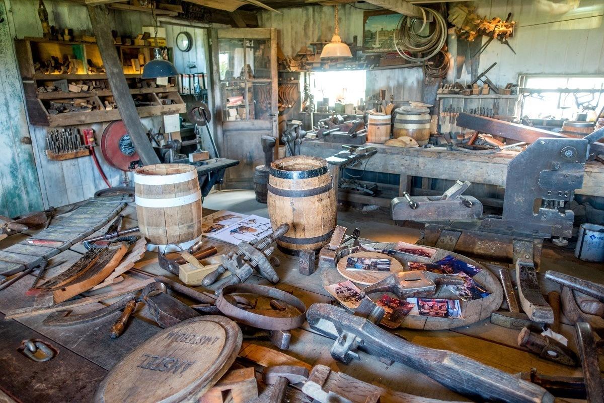 Barrel-making tools and finished barrels in a workshop