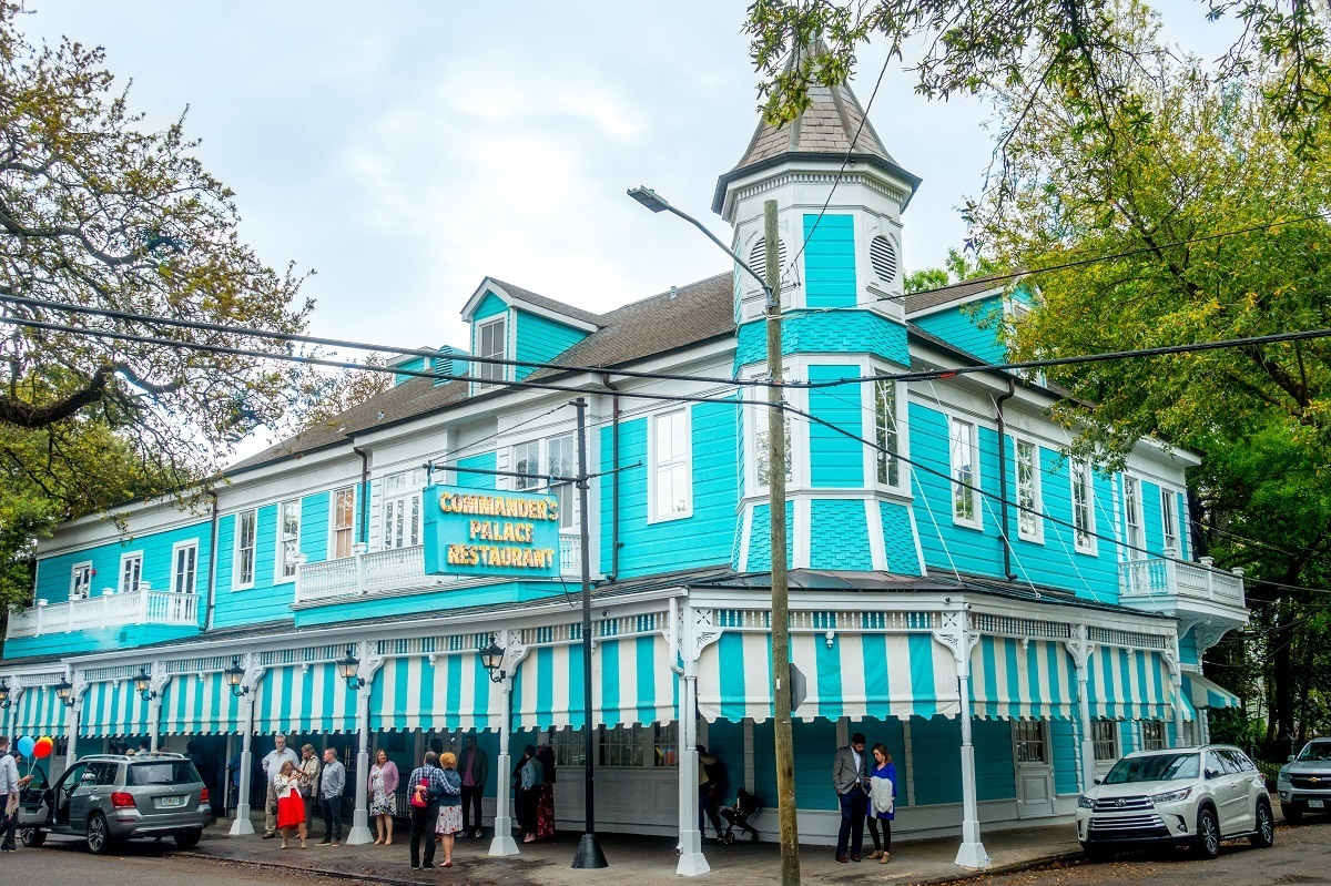 Turquoise and white striped exterior of Commander's Palace restaurant