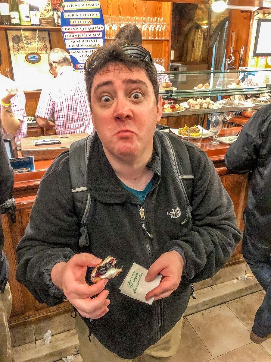 Lance eating something he didn't enjoy in San Sebastian, Spain