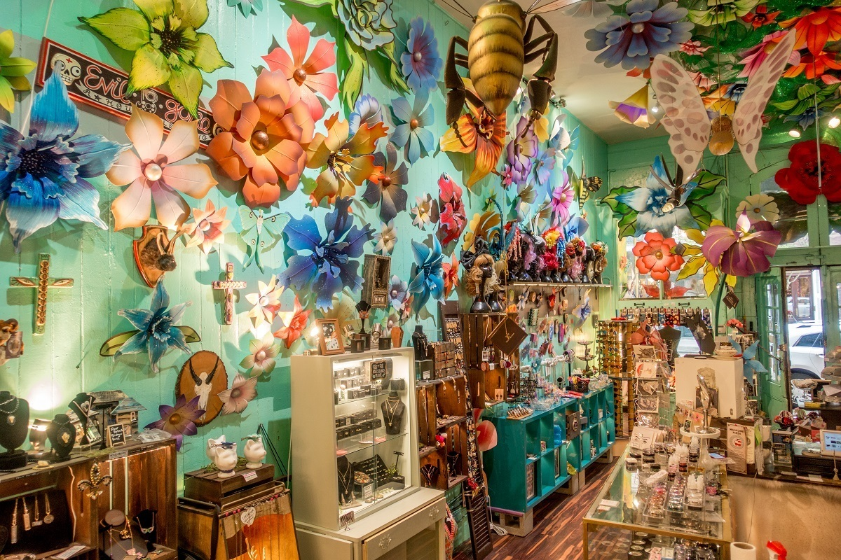 Jewelry and gift store with colorful interior and large flower decorations