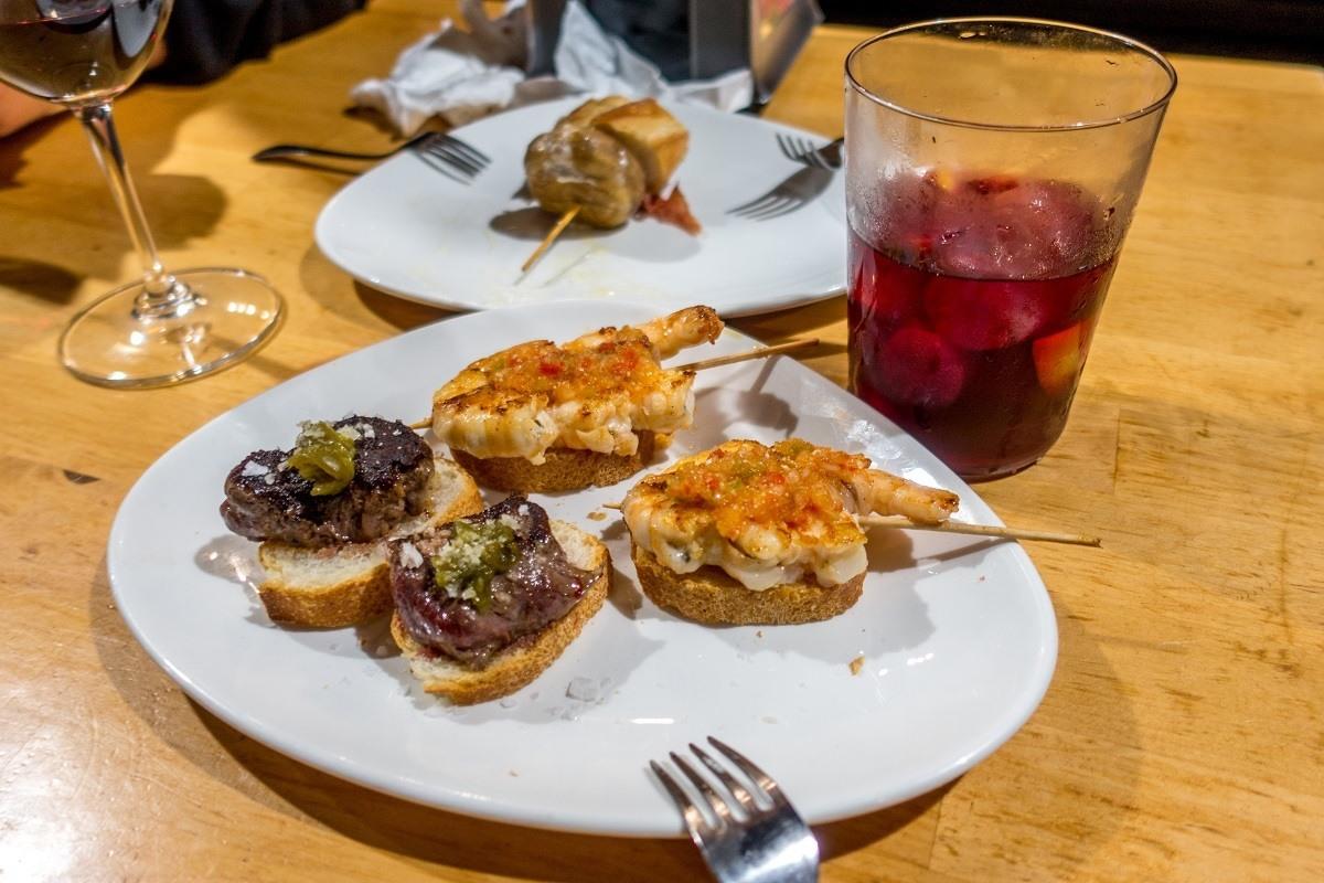 Beef sirlion pintxo and shrimp pintxo