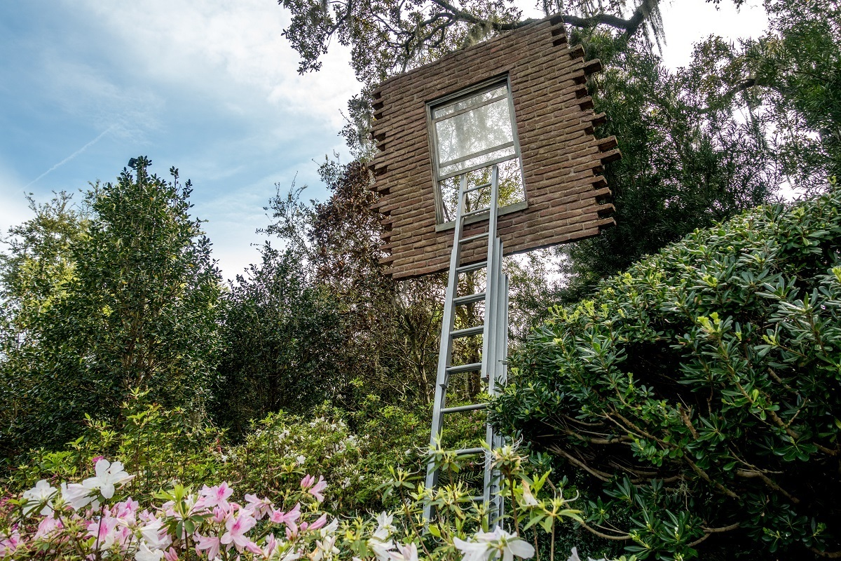 Step ladder leading to floating window in a garden