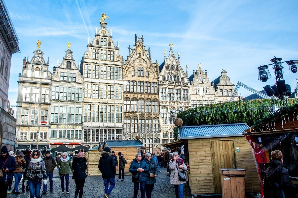 People visiting Christmas market stalls