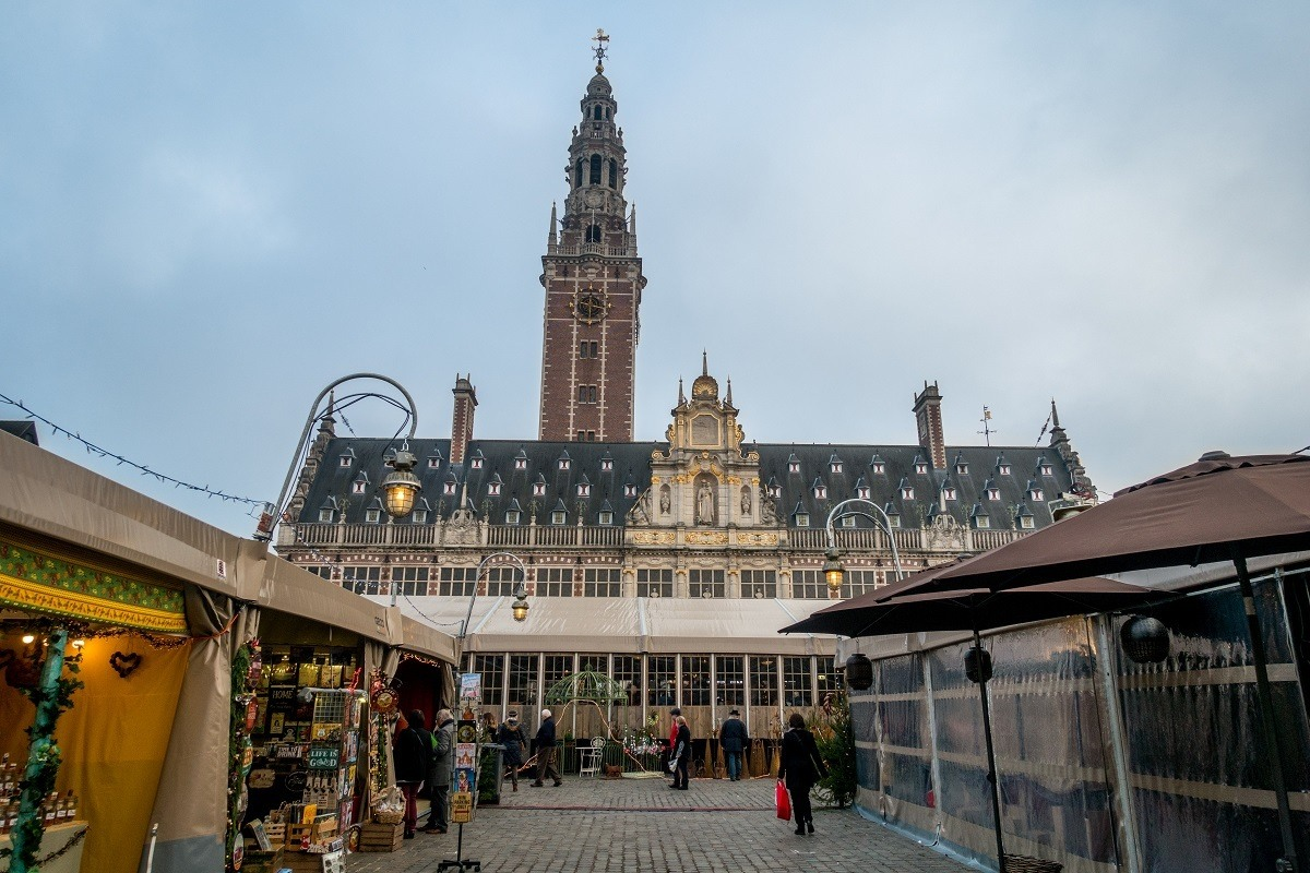 Market stalls in front of the large Leuven University library