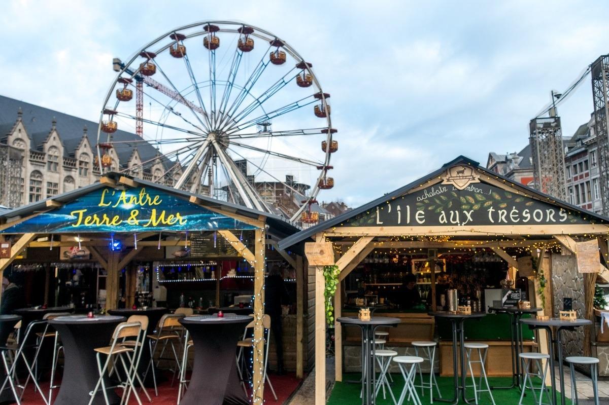 Market stalls and Ferris wheel