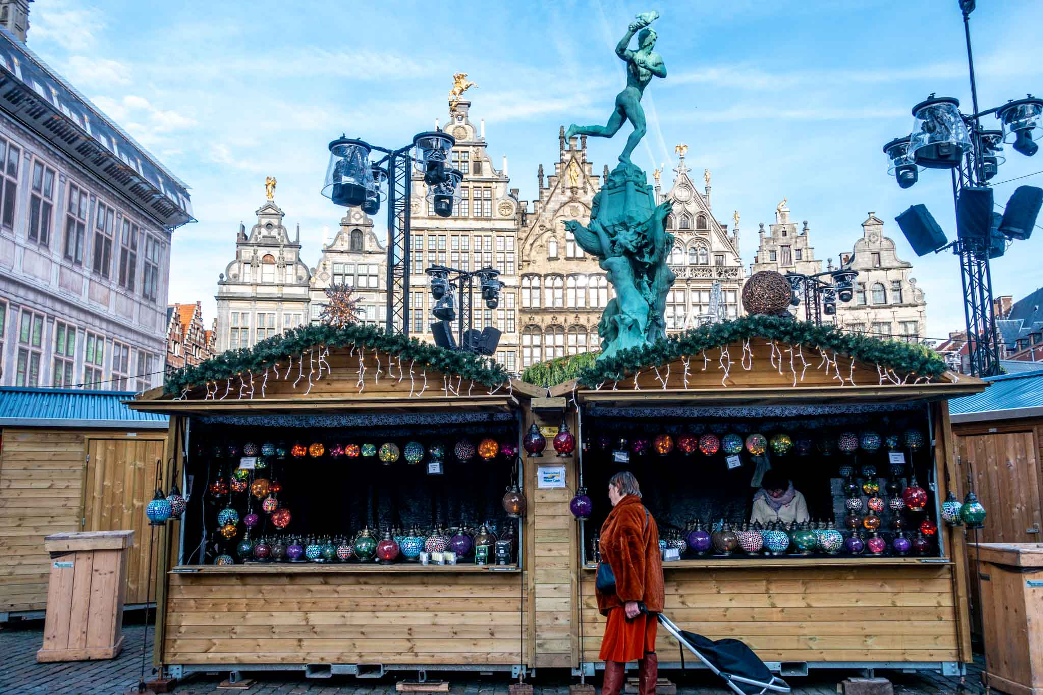 Woman shopping at market stalls in the city square