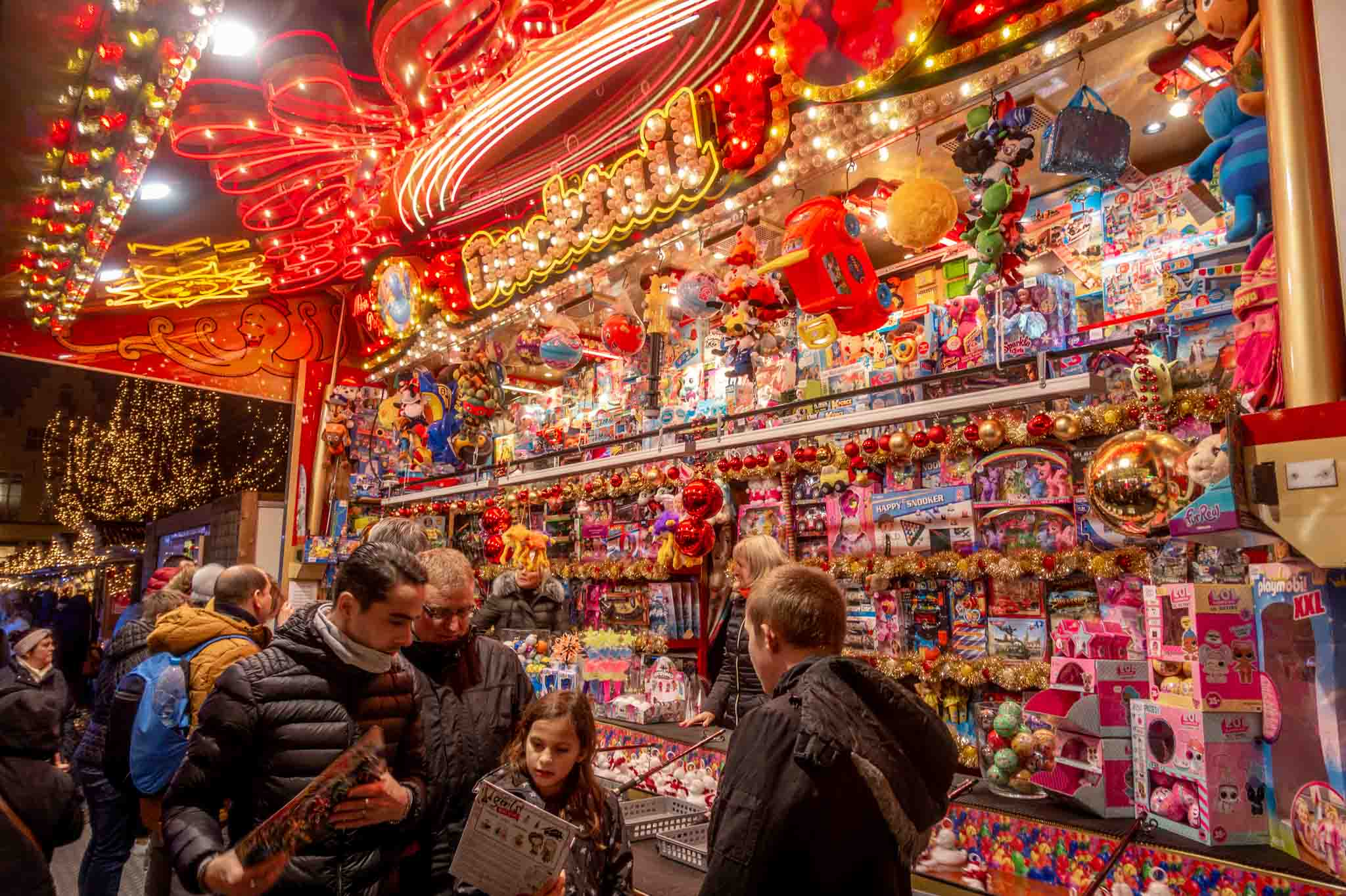 Shopping for toys at one of the brightly lit kiosks