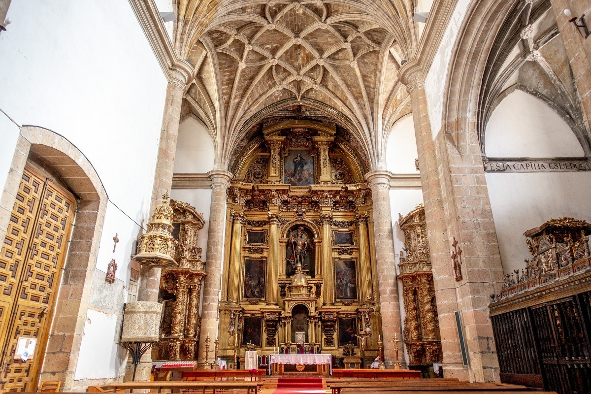 Golden altar and vaulted ceiling in a church