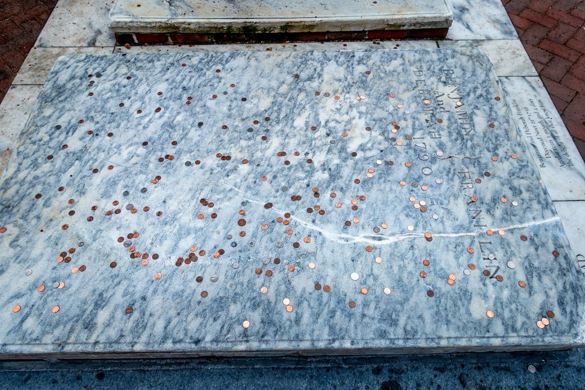 Benjamin Franklin's grave covered with pennies