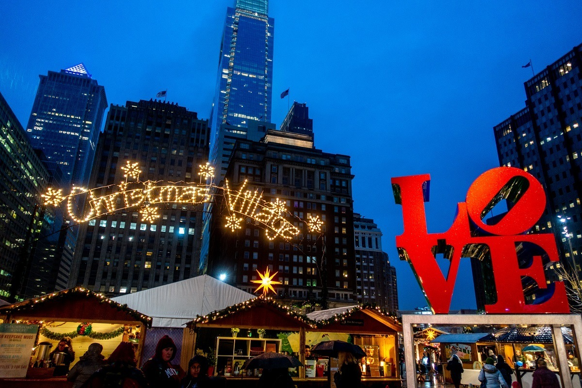 Christmas market stalls in LOVE Park with red LOVE statue
