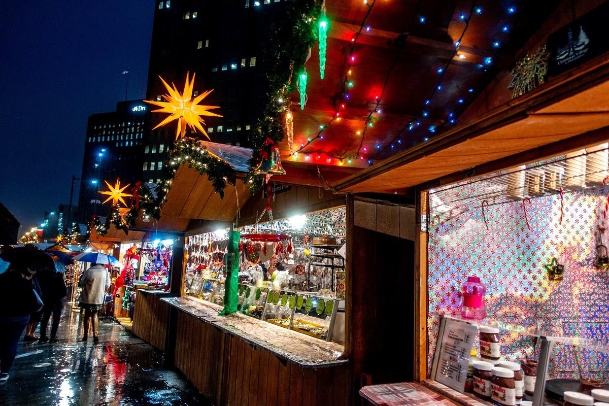 Christmas market stalls lit up at night