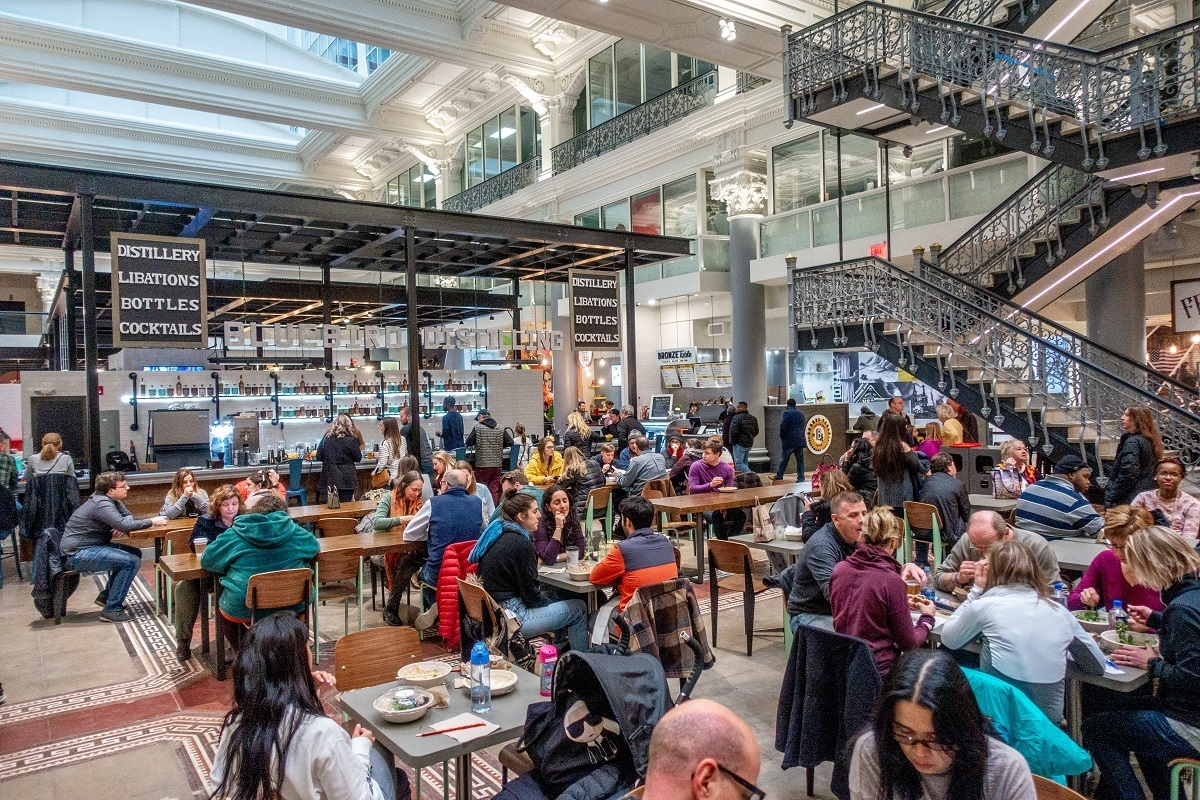 People eating at tables in a food hall