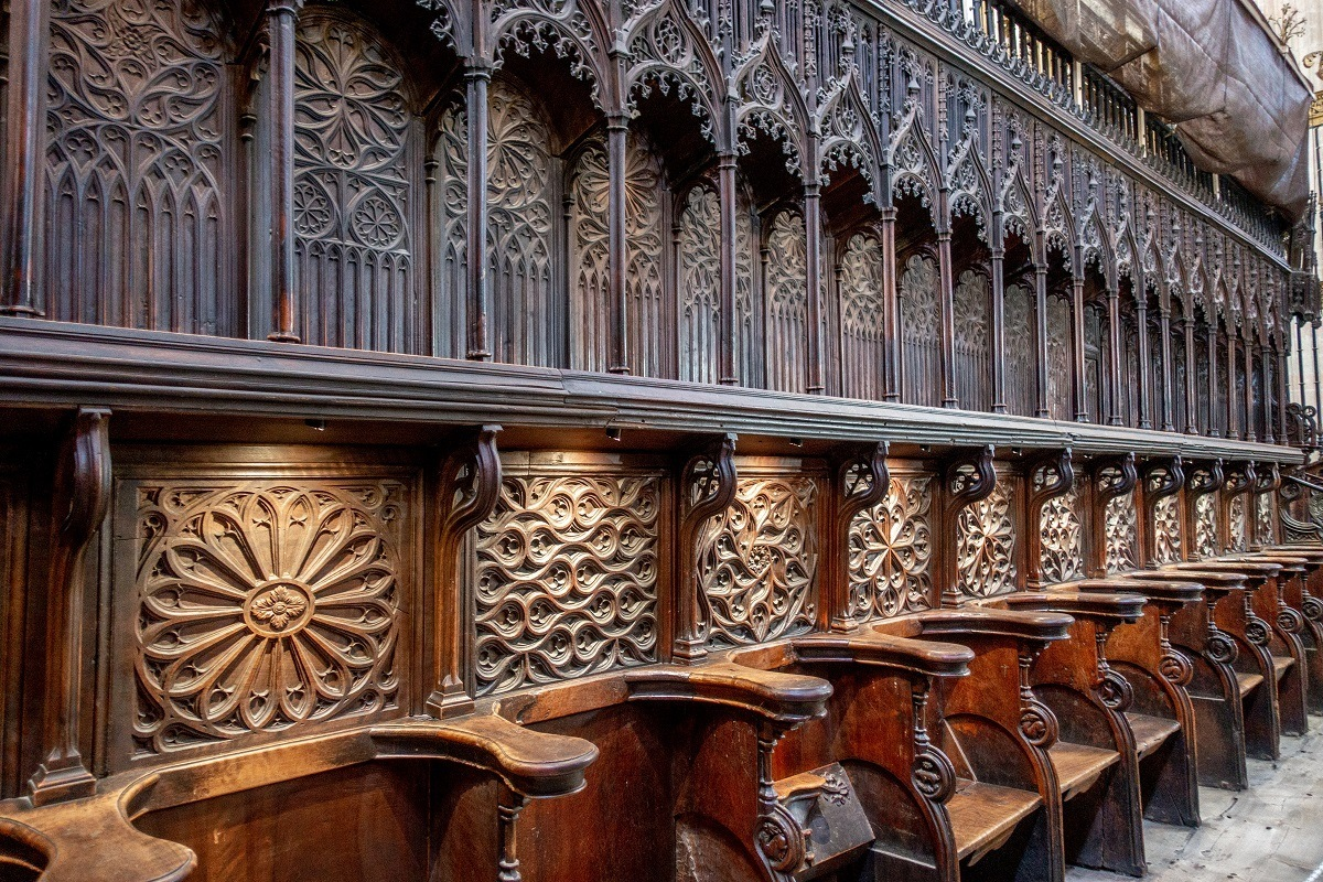 Ornately-carved wooden choir seating