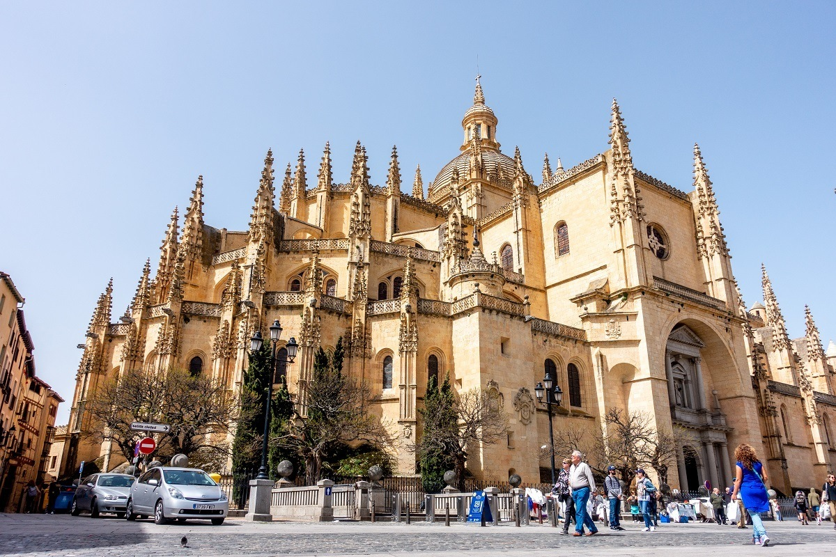 Yellow exterior of a cathedral with spires