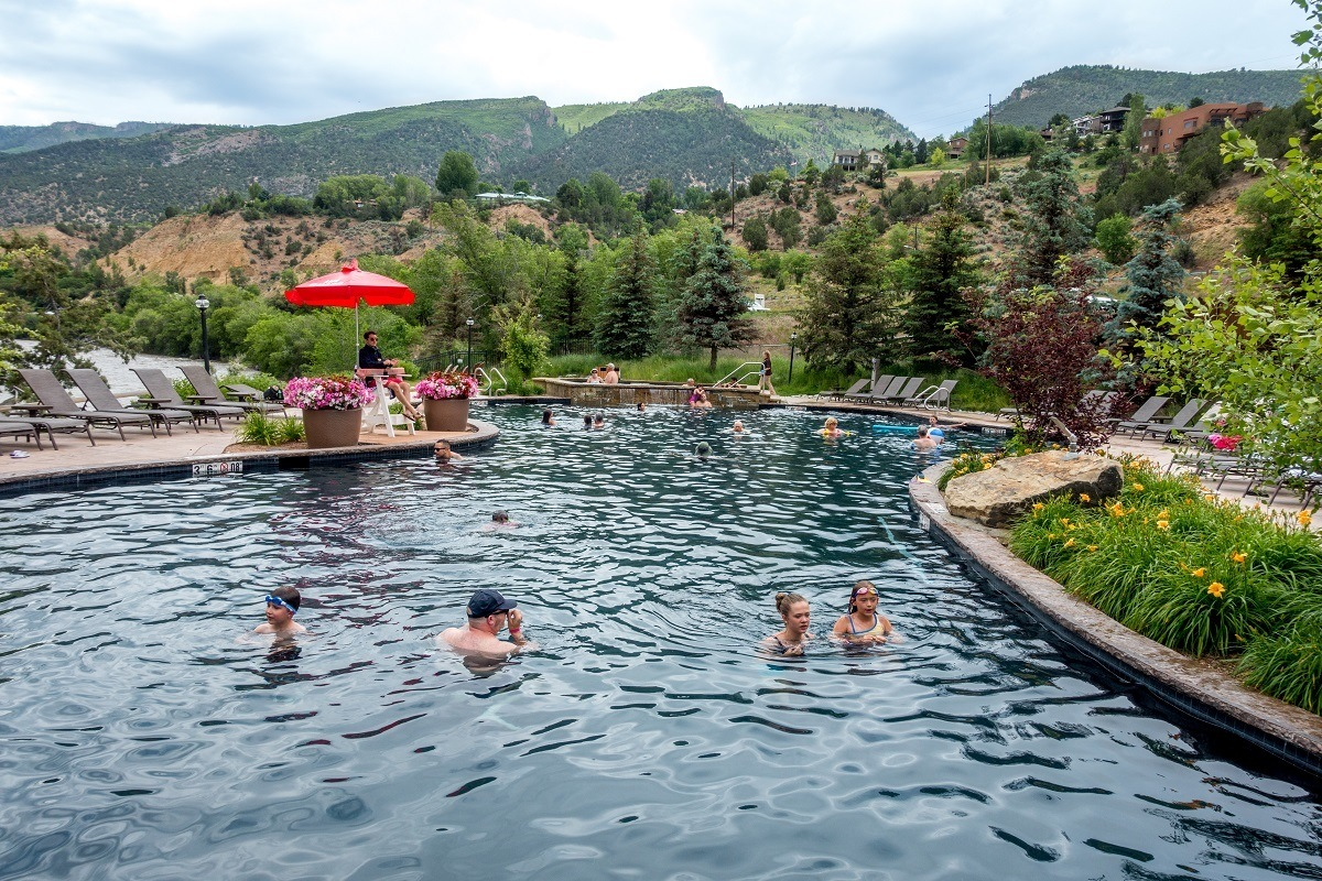 People swimming in a hot springs pool in the mountains