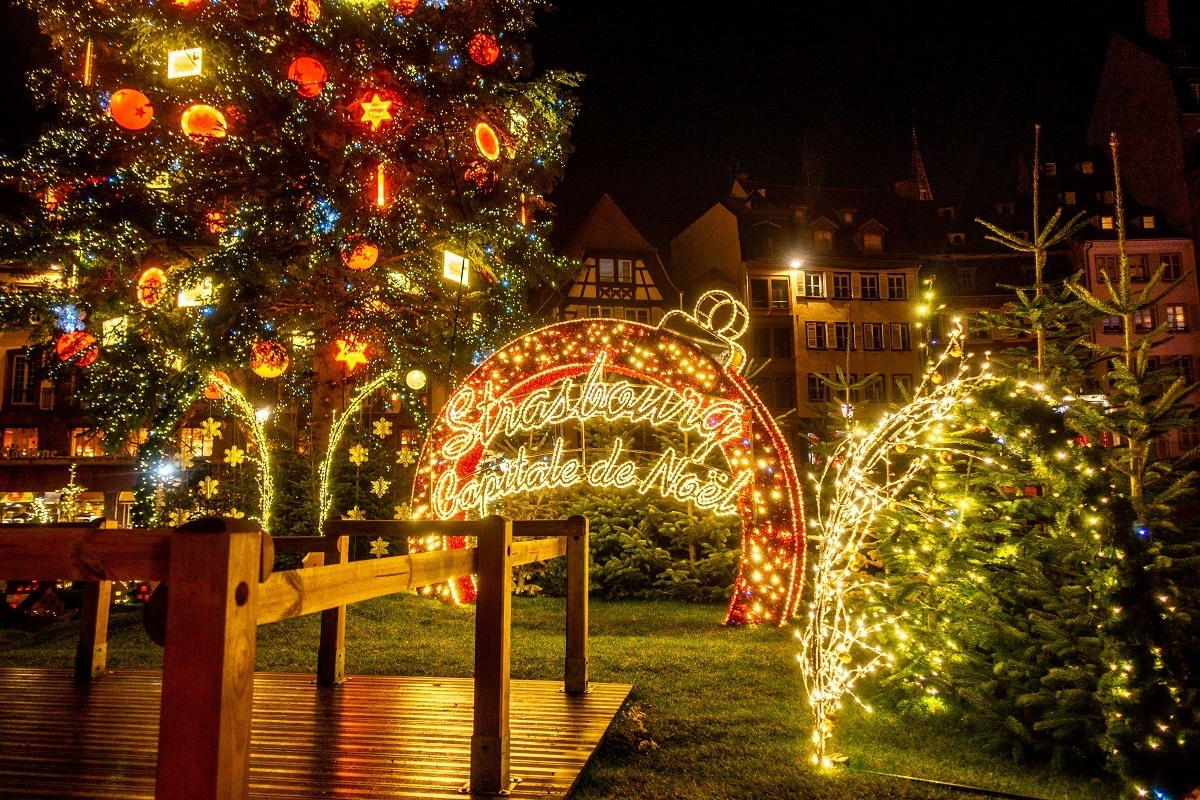 "Lit up sign ""Strasbourg: Capitale de Noel"" at night"