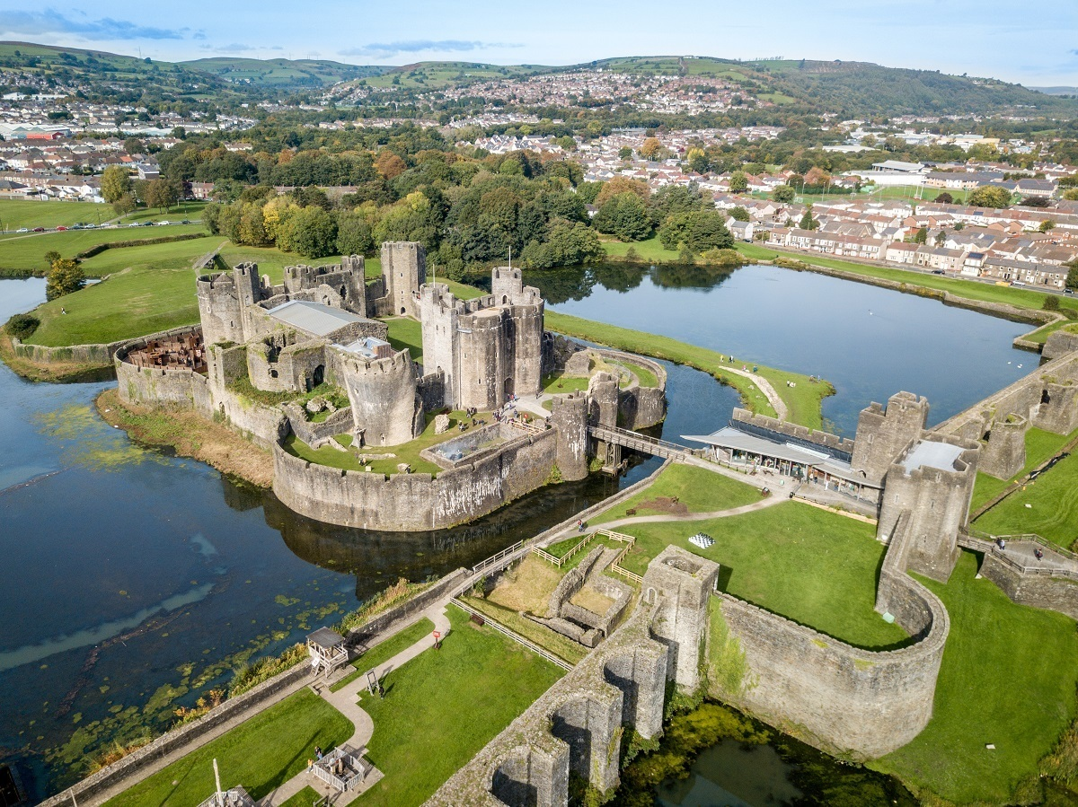 Aerial view of towers, bridge, and a moat at a castle