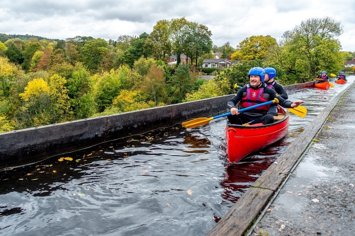 Kayakers paddling over an aqueduct