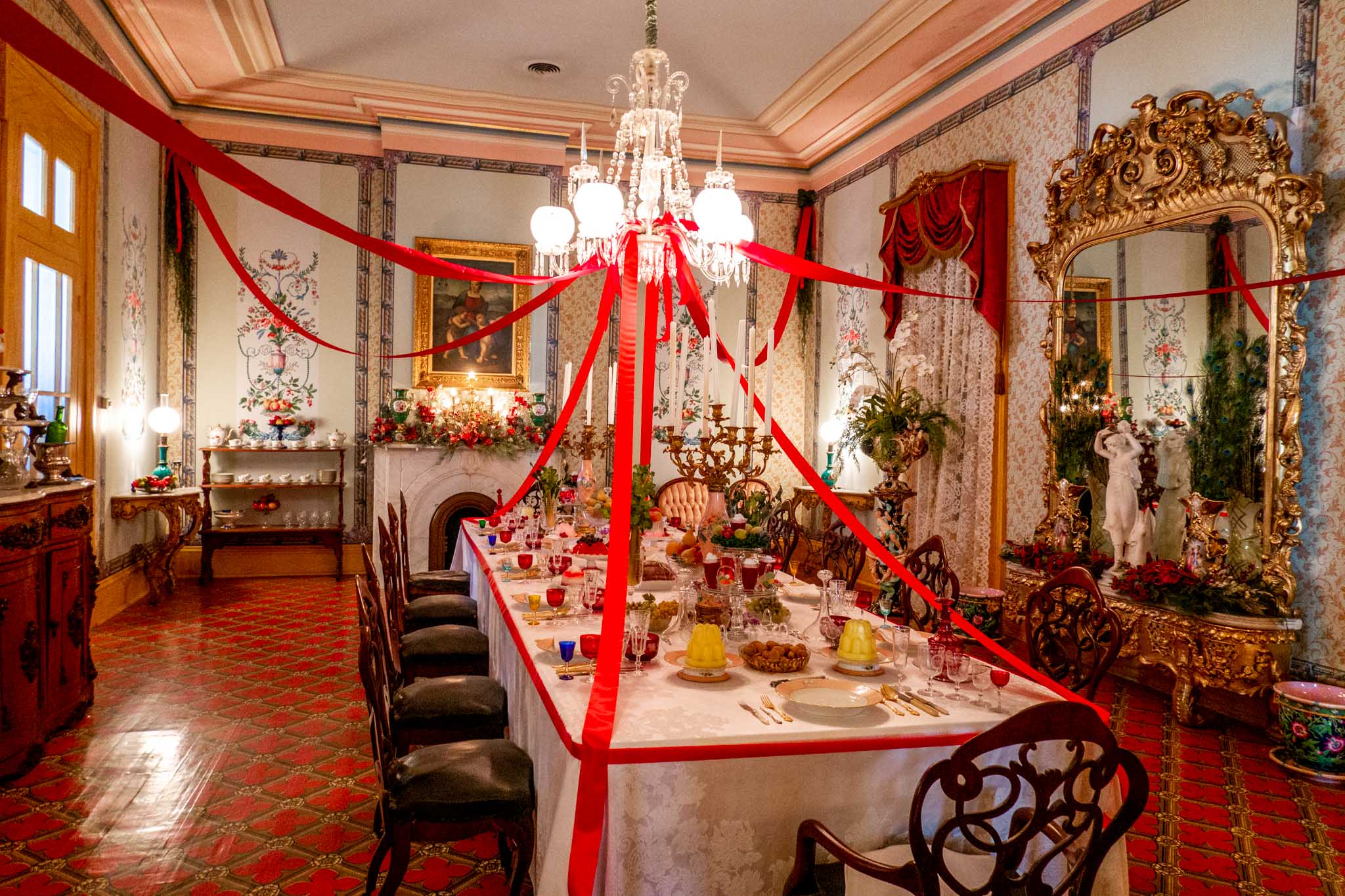 Formal dining room with set table and Christmas decorations