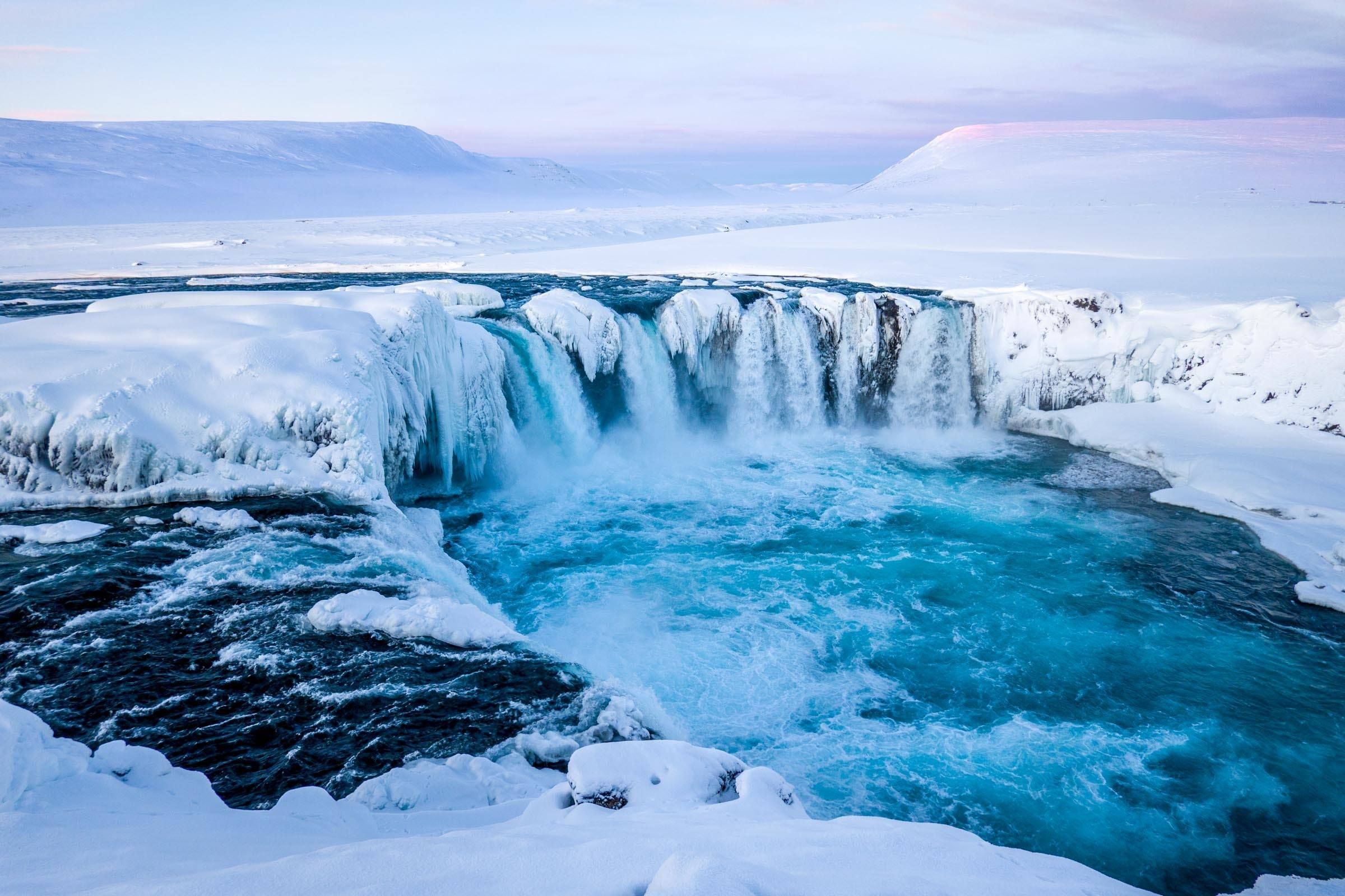 Iceland waterfall covered in ice and snow