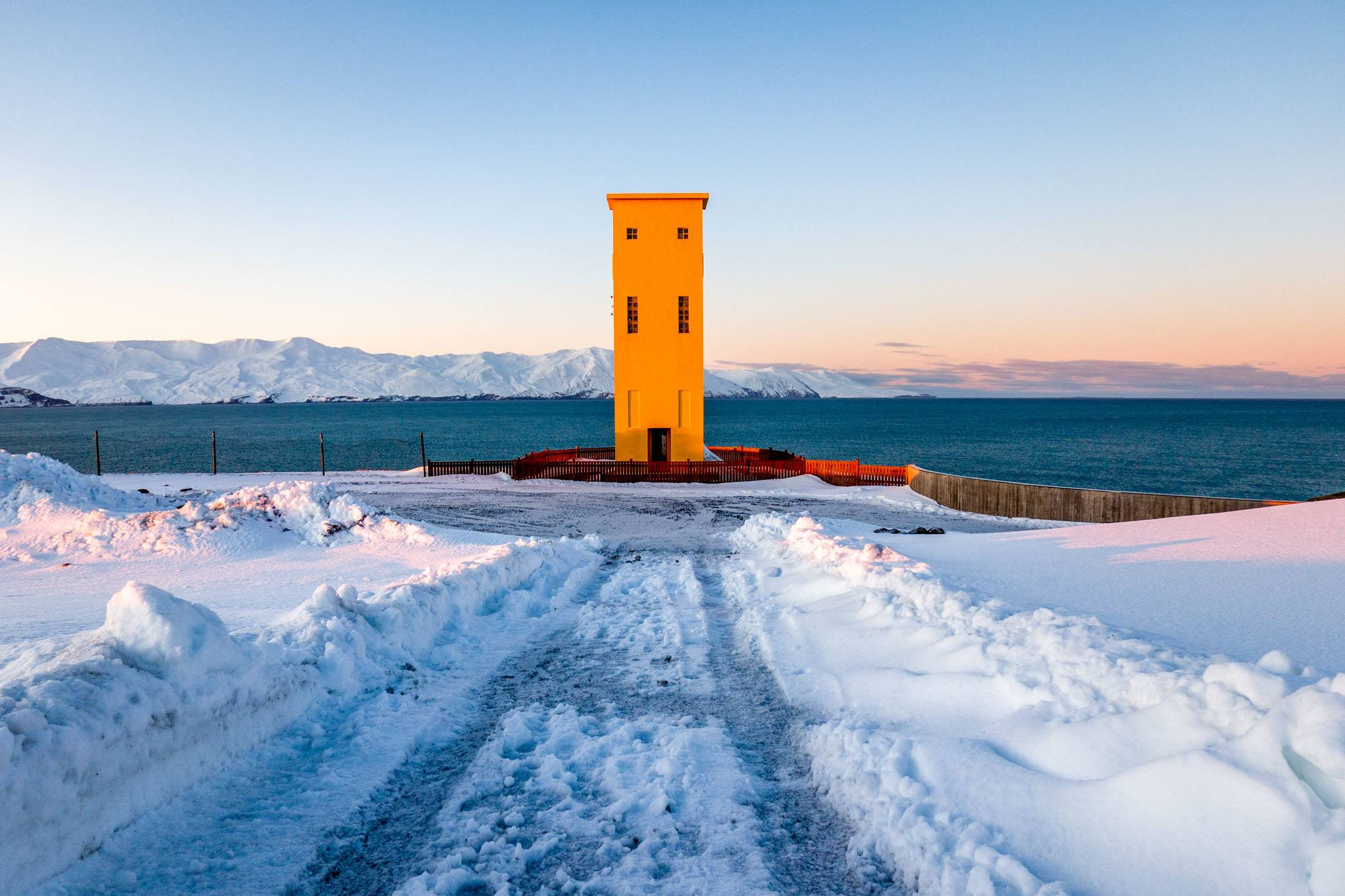 Yellow lighthouse in the snow