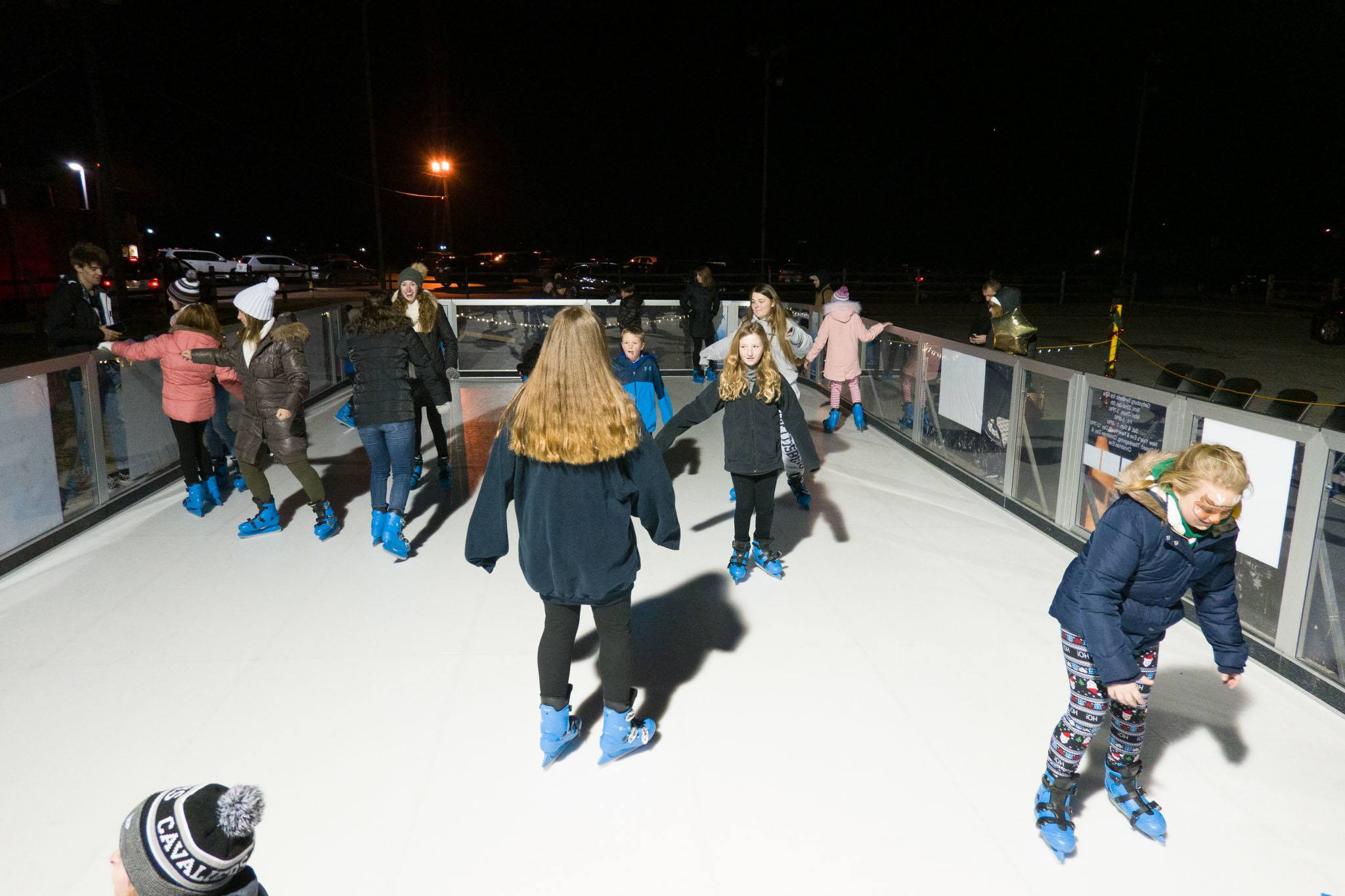 Kids ice skating at night
