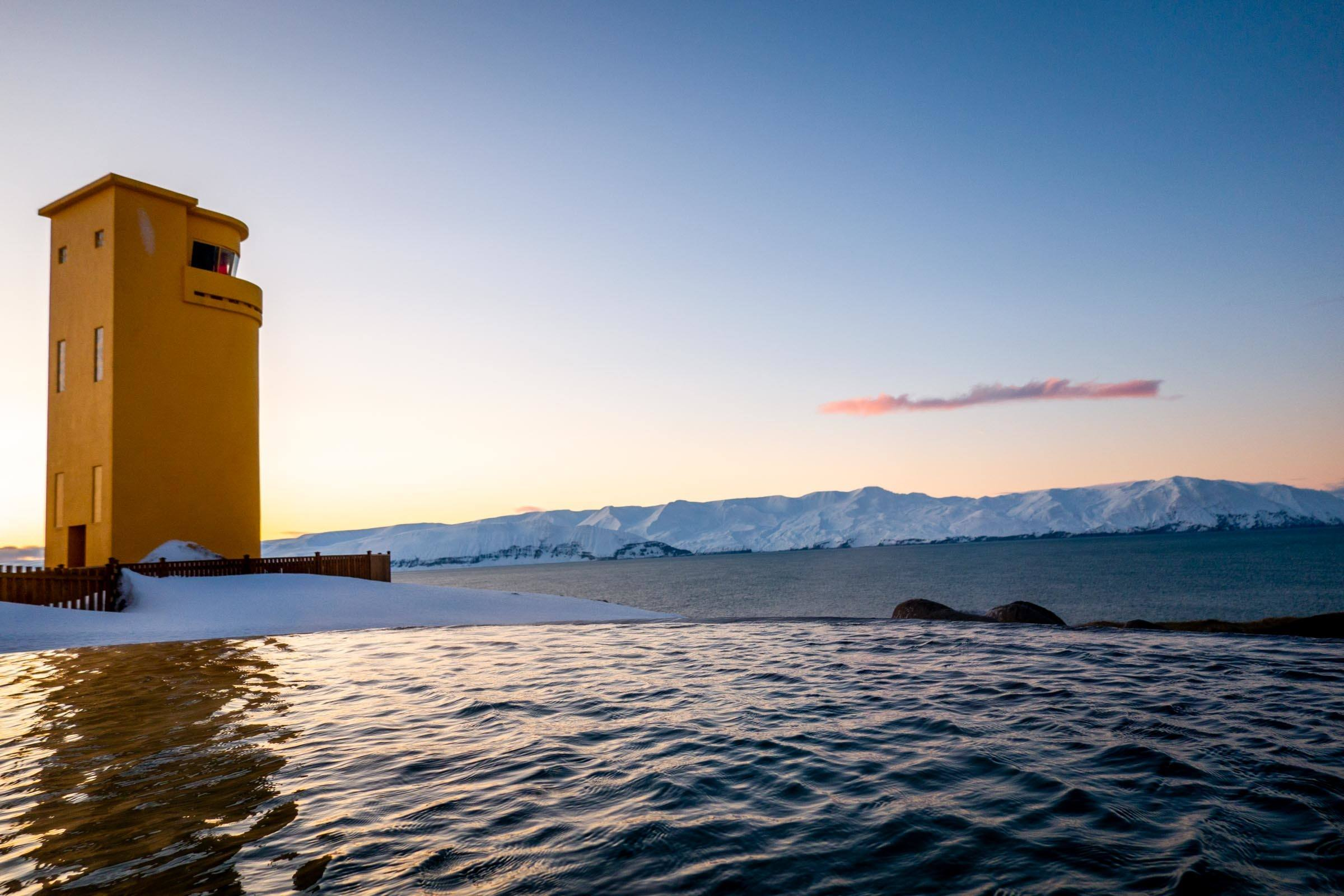 Yellow lighthouse beside thermal baths