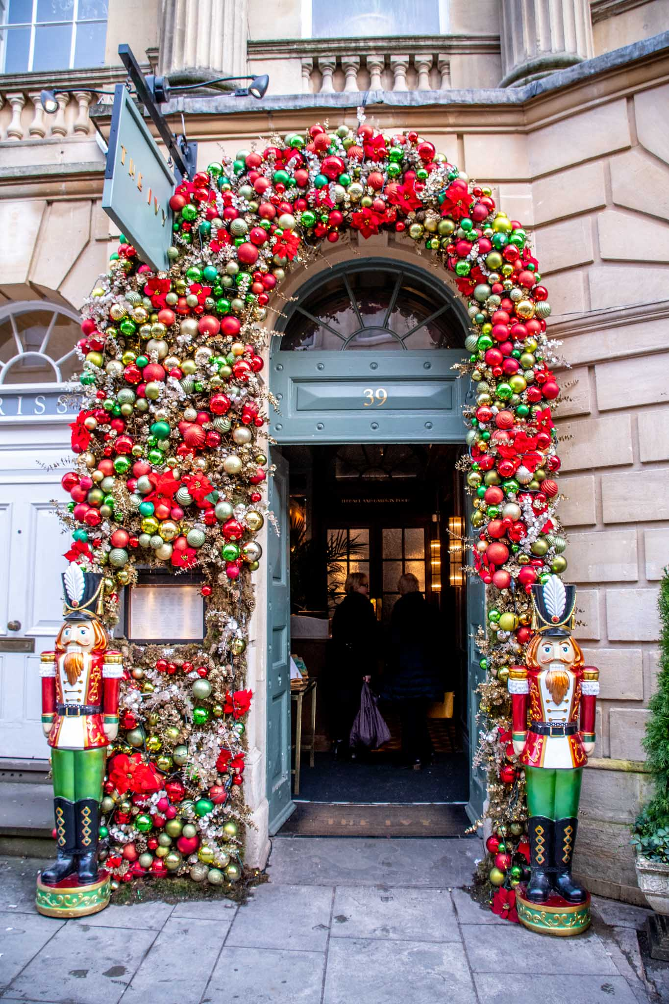 Doorway covered in ornaments and flanked by two nutcrackers