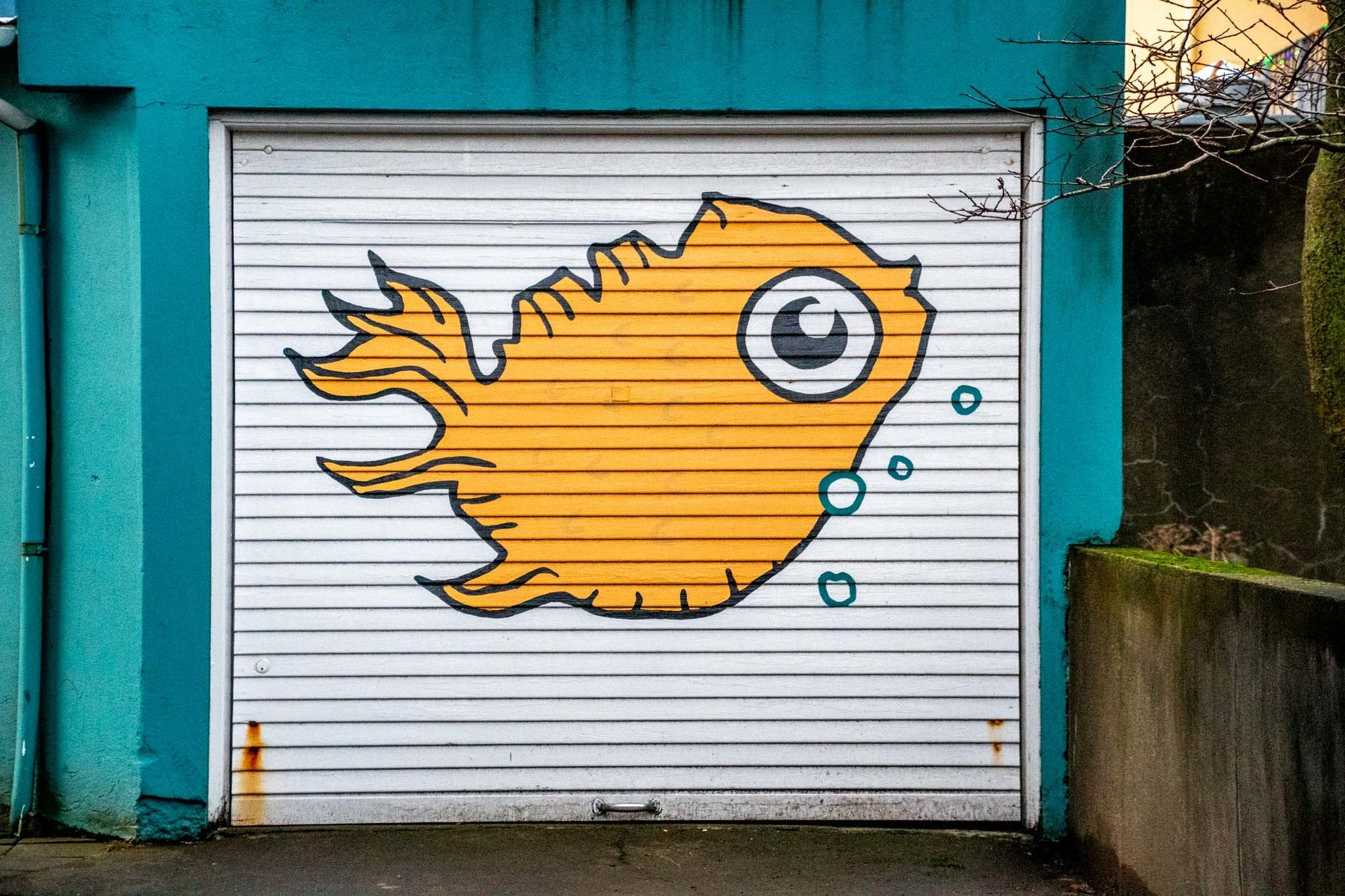 Fish mural in the shape of Iceland on a garage in downtown Reykjavik