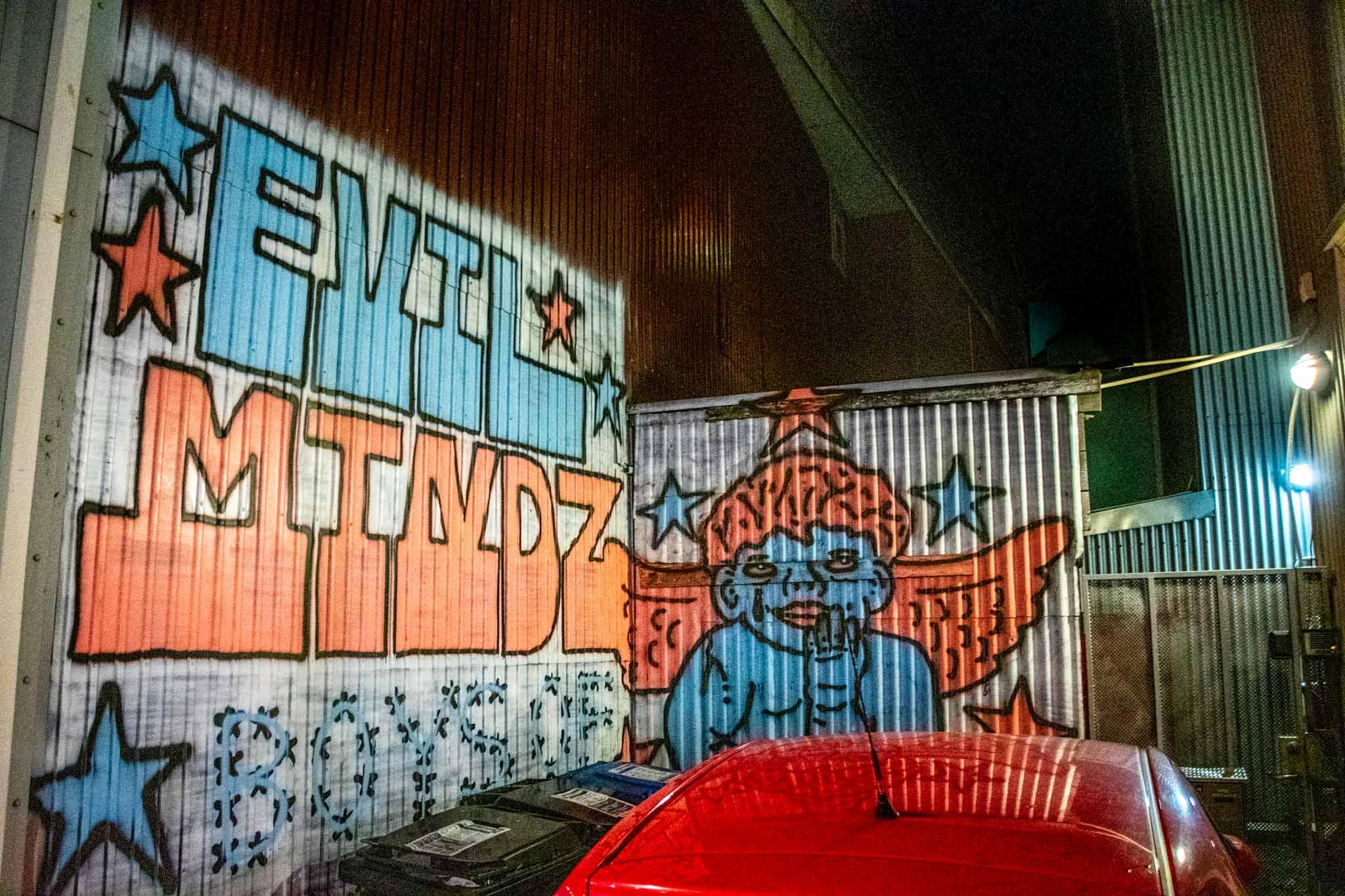 Evil Mindz mural in someone's driveway in Reykjavik