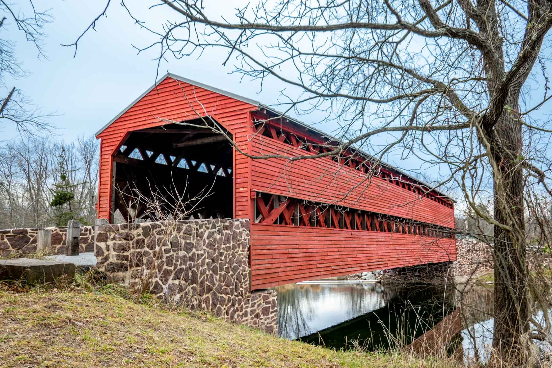 Red covered bridge over a creek