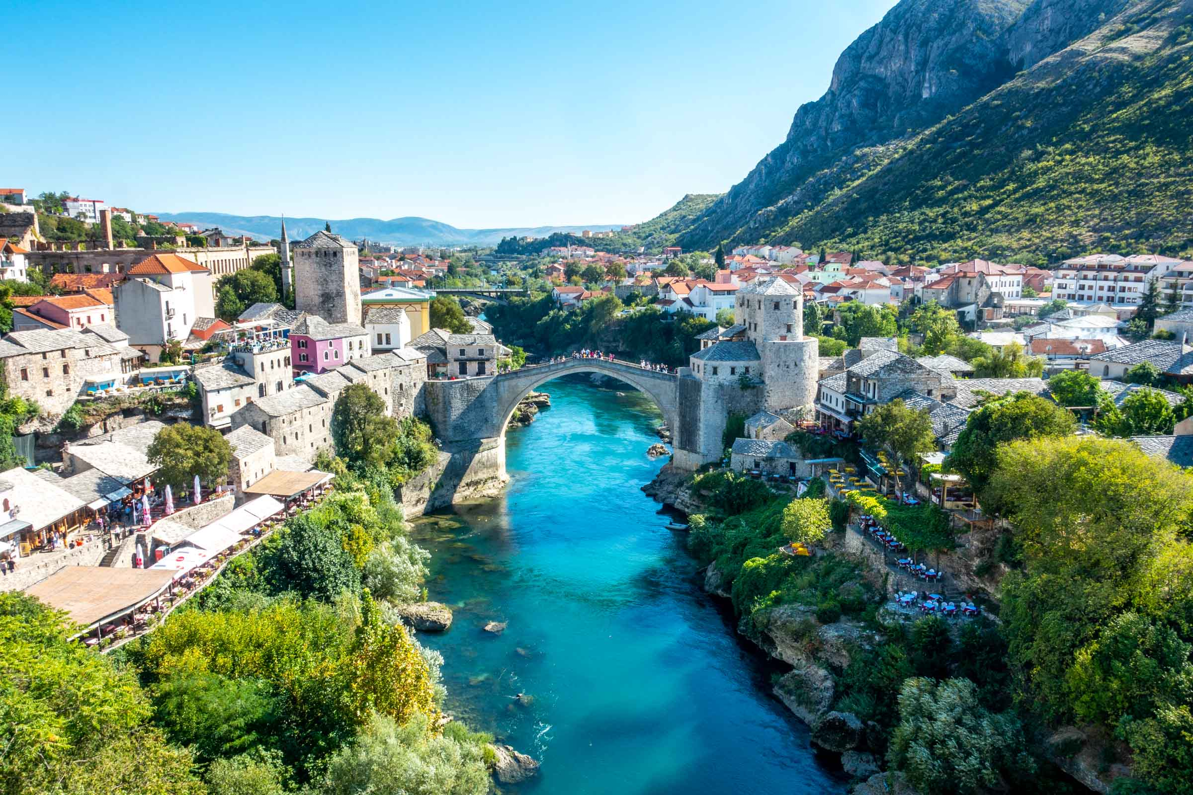 Stone bridge (Stari Most) over a river with buildings on both riverbanks