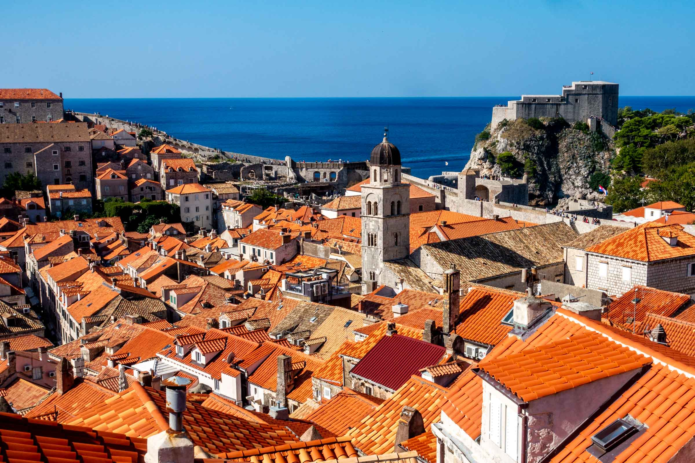 View of red roofs, bell tower, and ancient Dubrovnik city walls