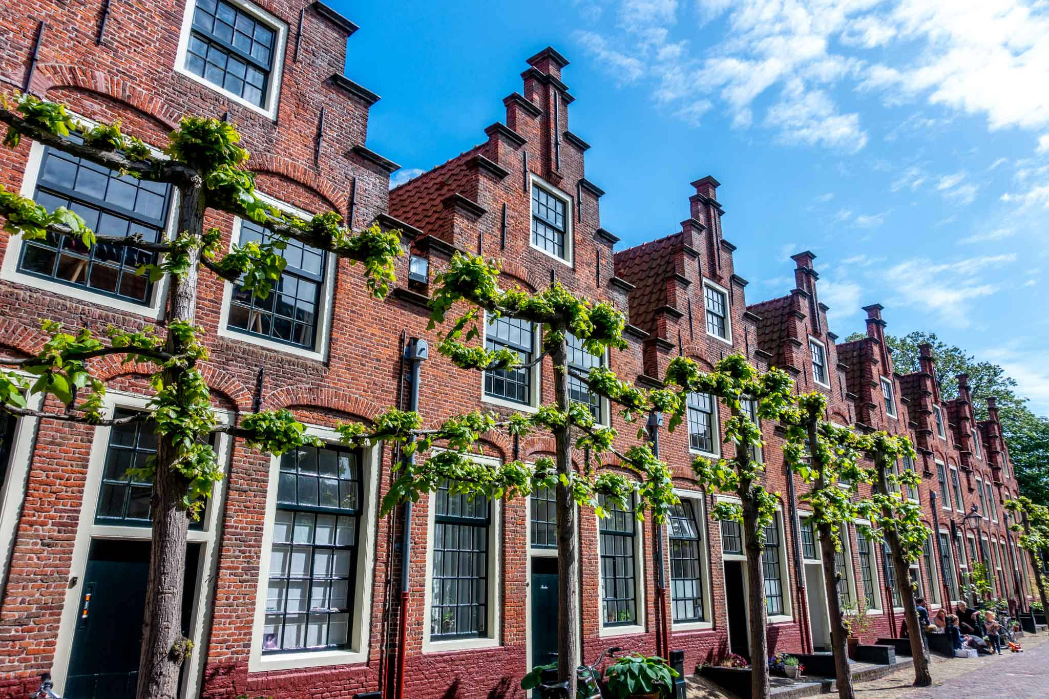 Row of red brick Dutch houses with step gabled roofs