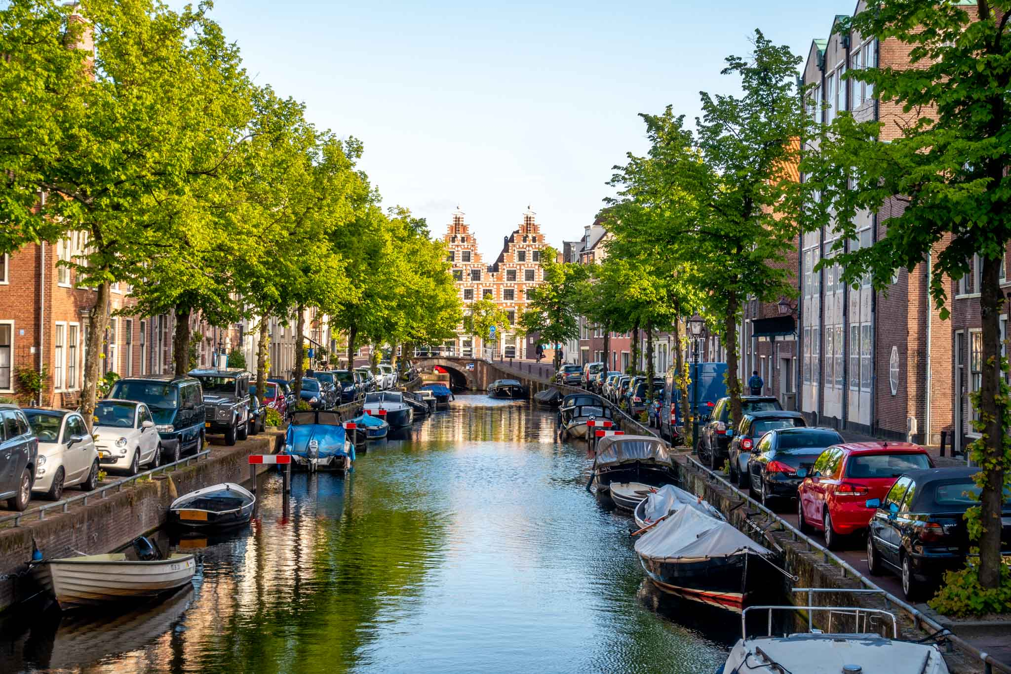 Boats and houses along a canal near sunset in Haarlem, Netherlands