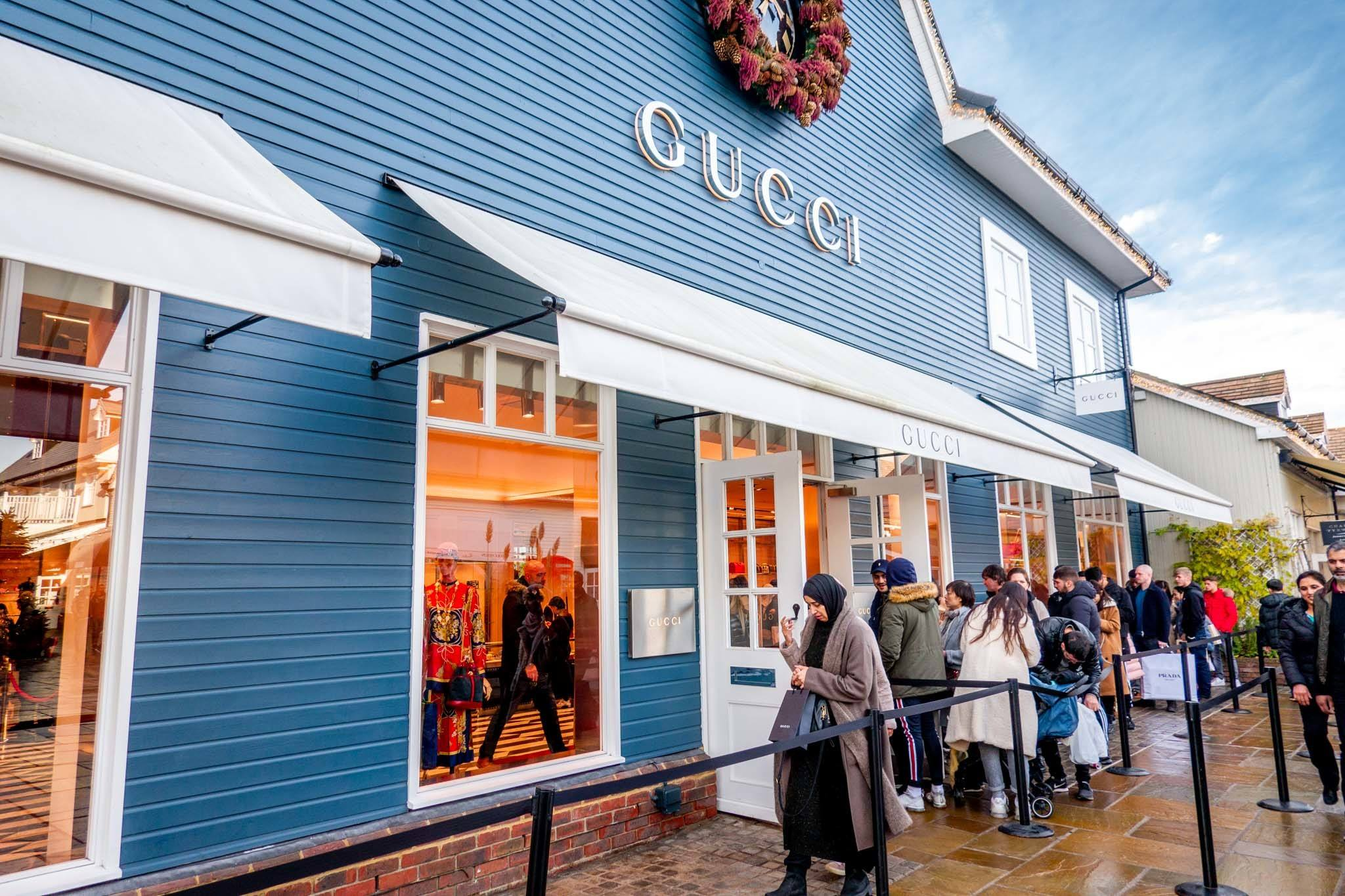 Line of people outside a Gucci store