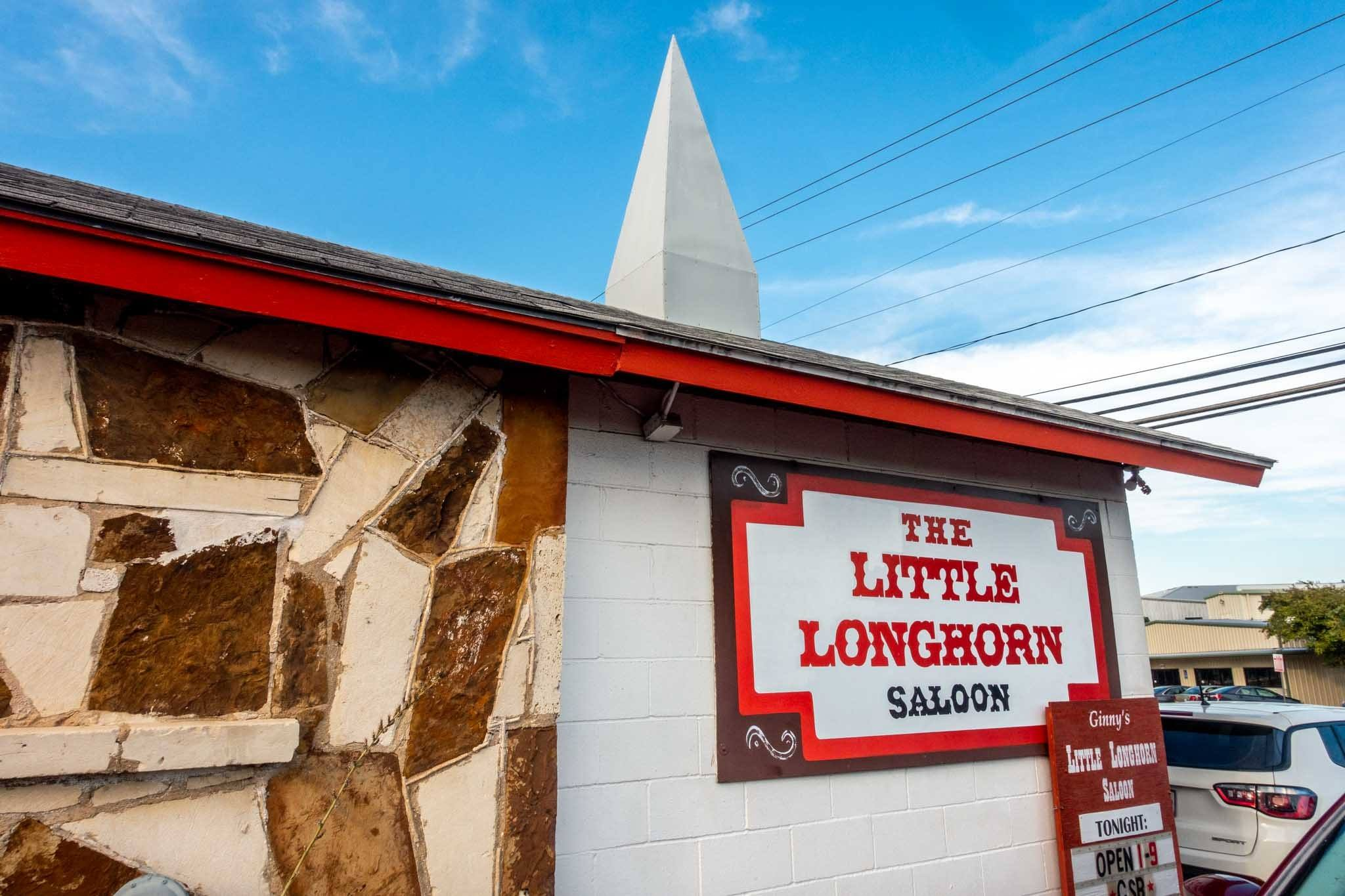 Small white building with a steeple, The Little Longhorn Saloon