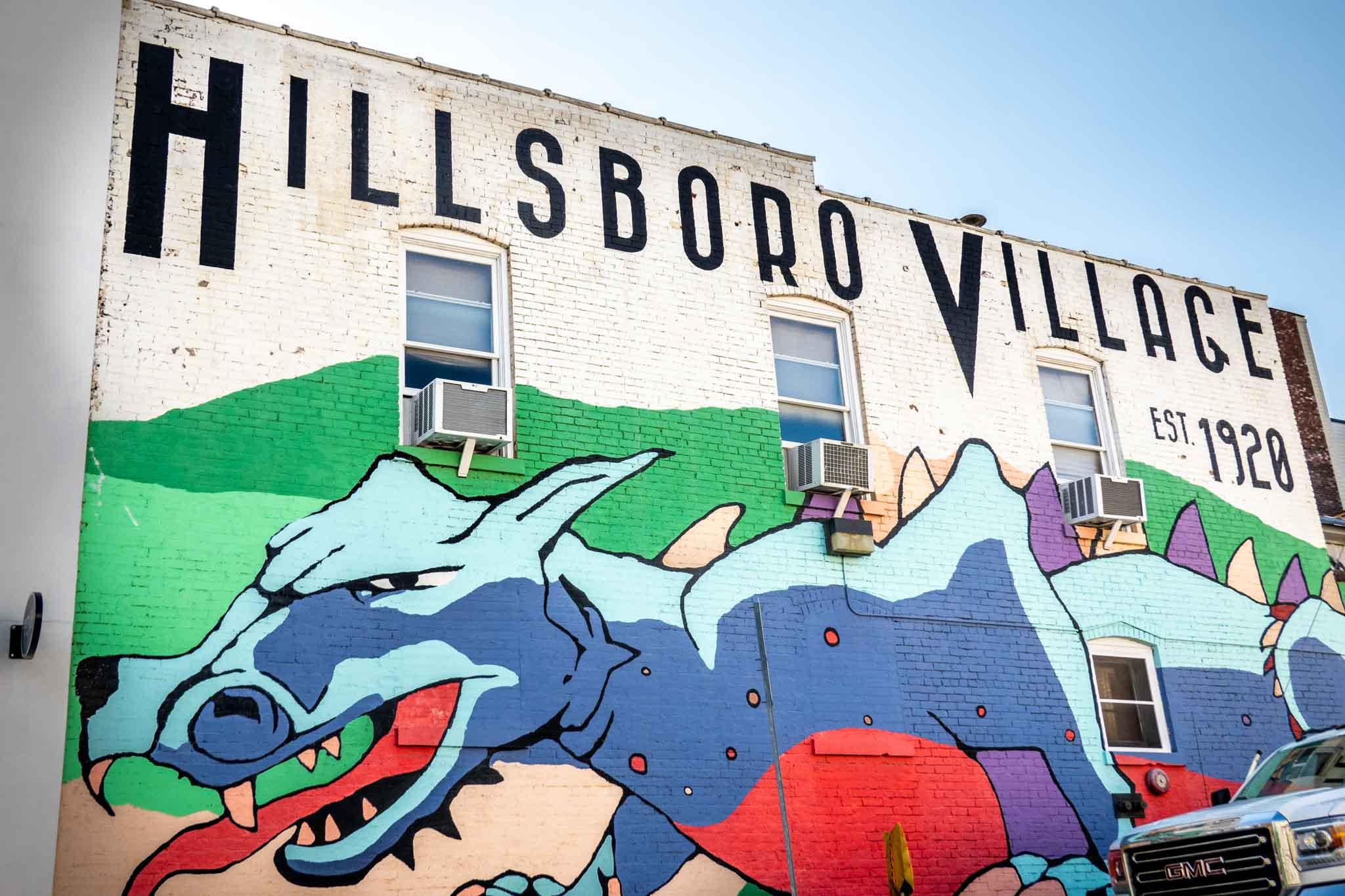 """Mural of a multi-colored dragon labeled """"Hillsboro Village, est. 1920"""""""