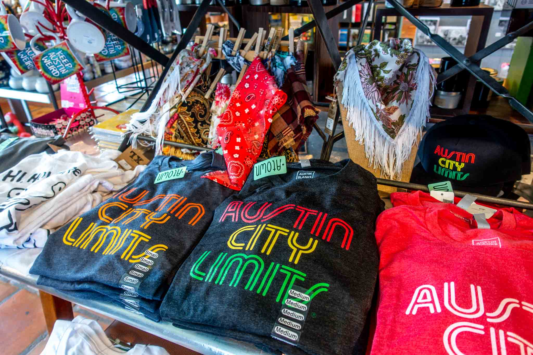 T-shirts and hats on display for sale