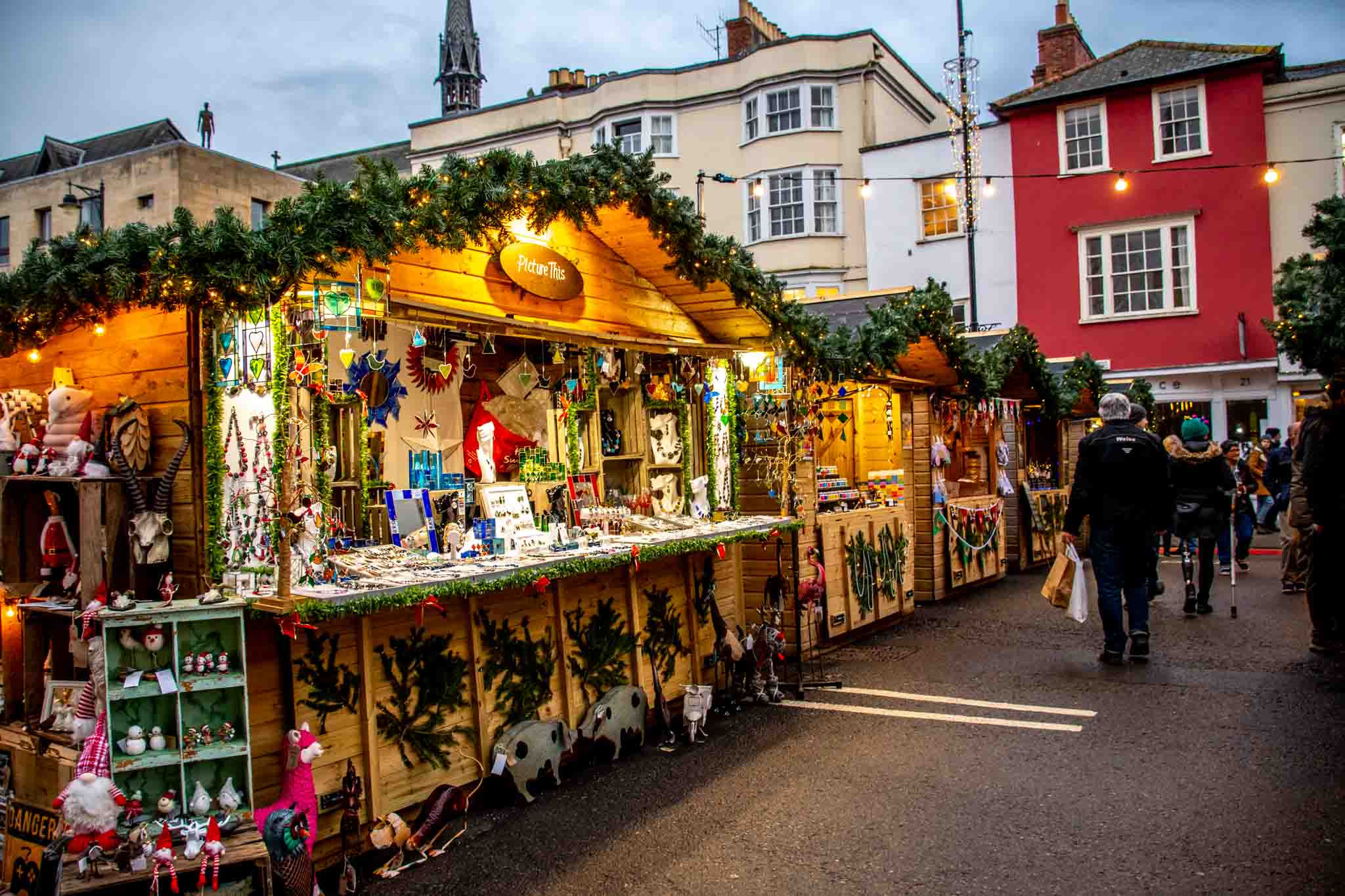 Wooden chalets seeling merchandise at the Oxford Christmas Market in England