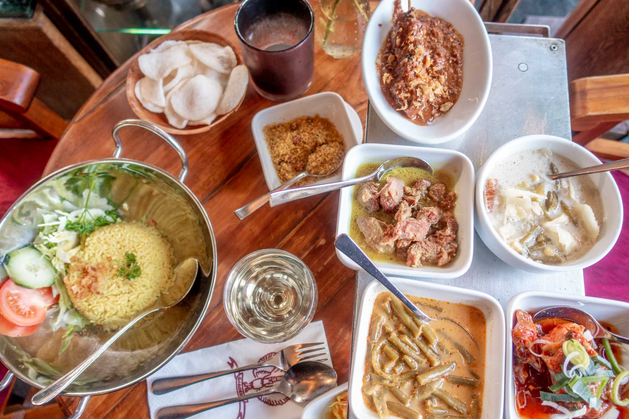 Lots of Indonesian food dishes in bowls on a table