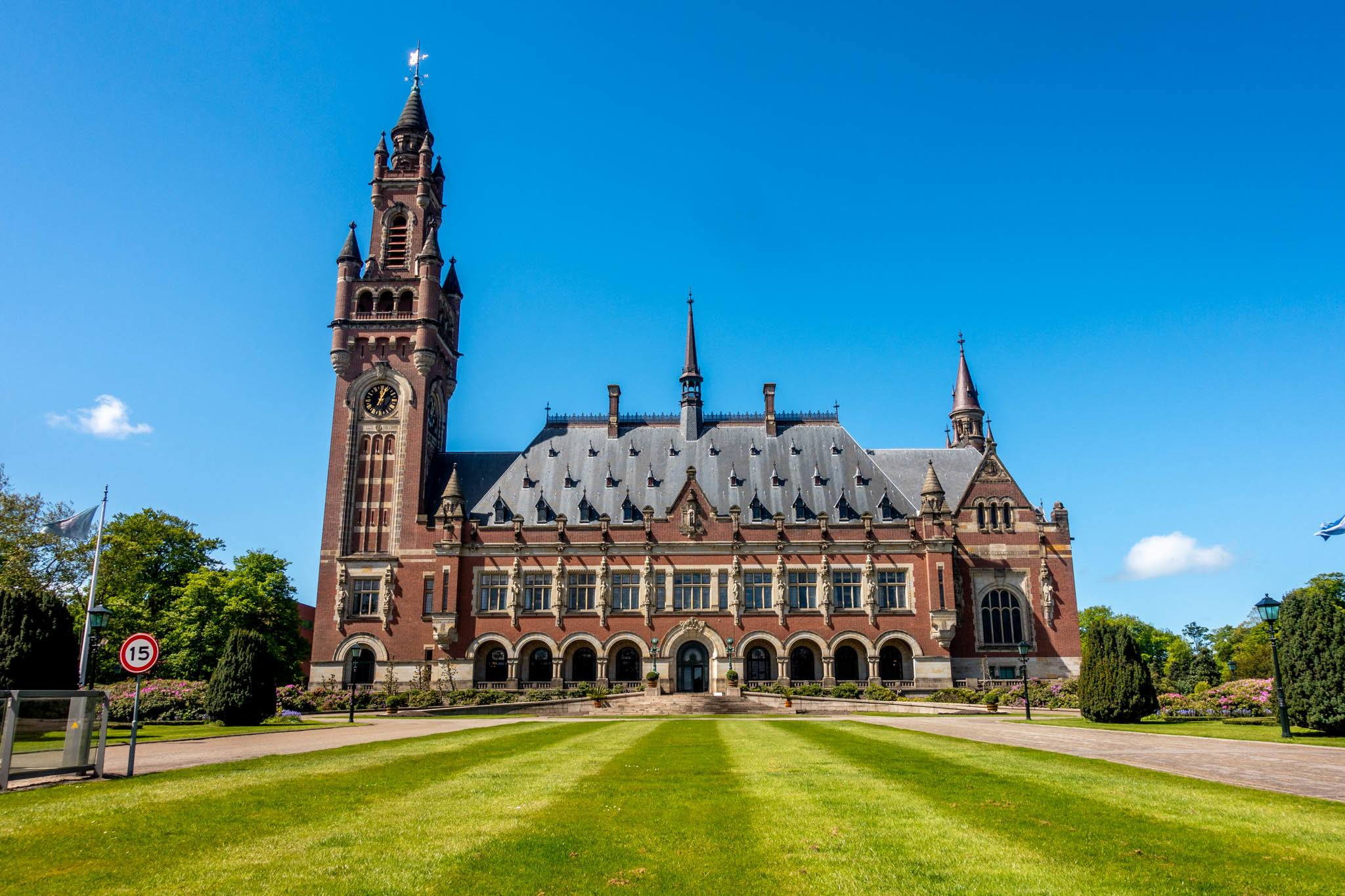 Large brick building with a clock tower, the Peace Palace in The Hague