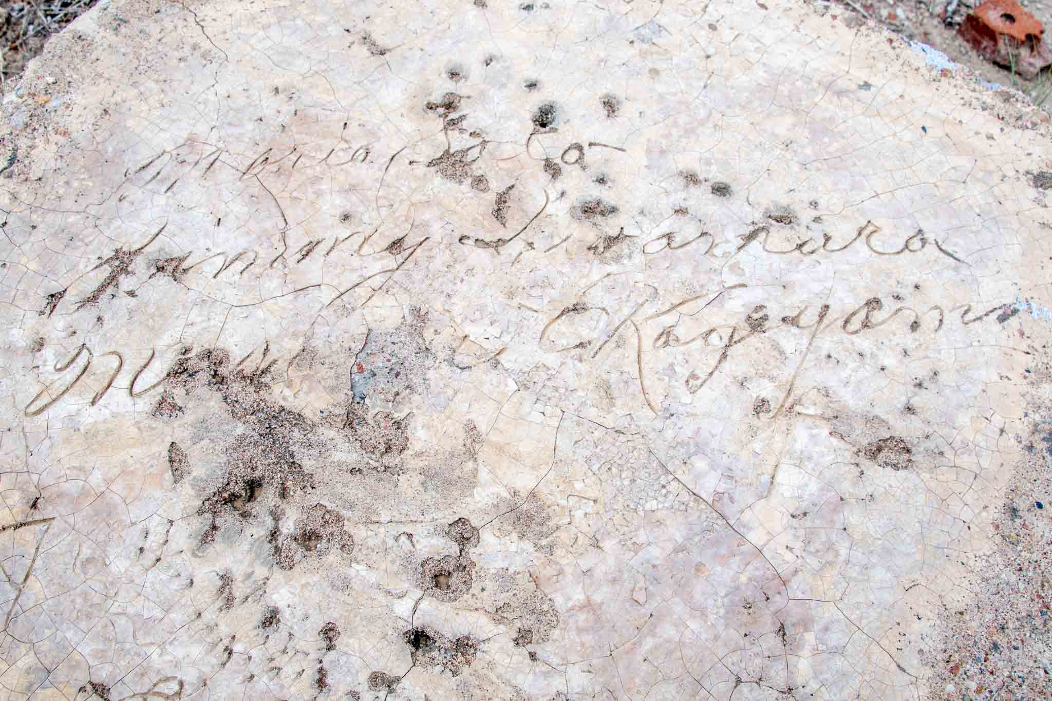 Names of prisoners signed into concrete at Camp Amache