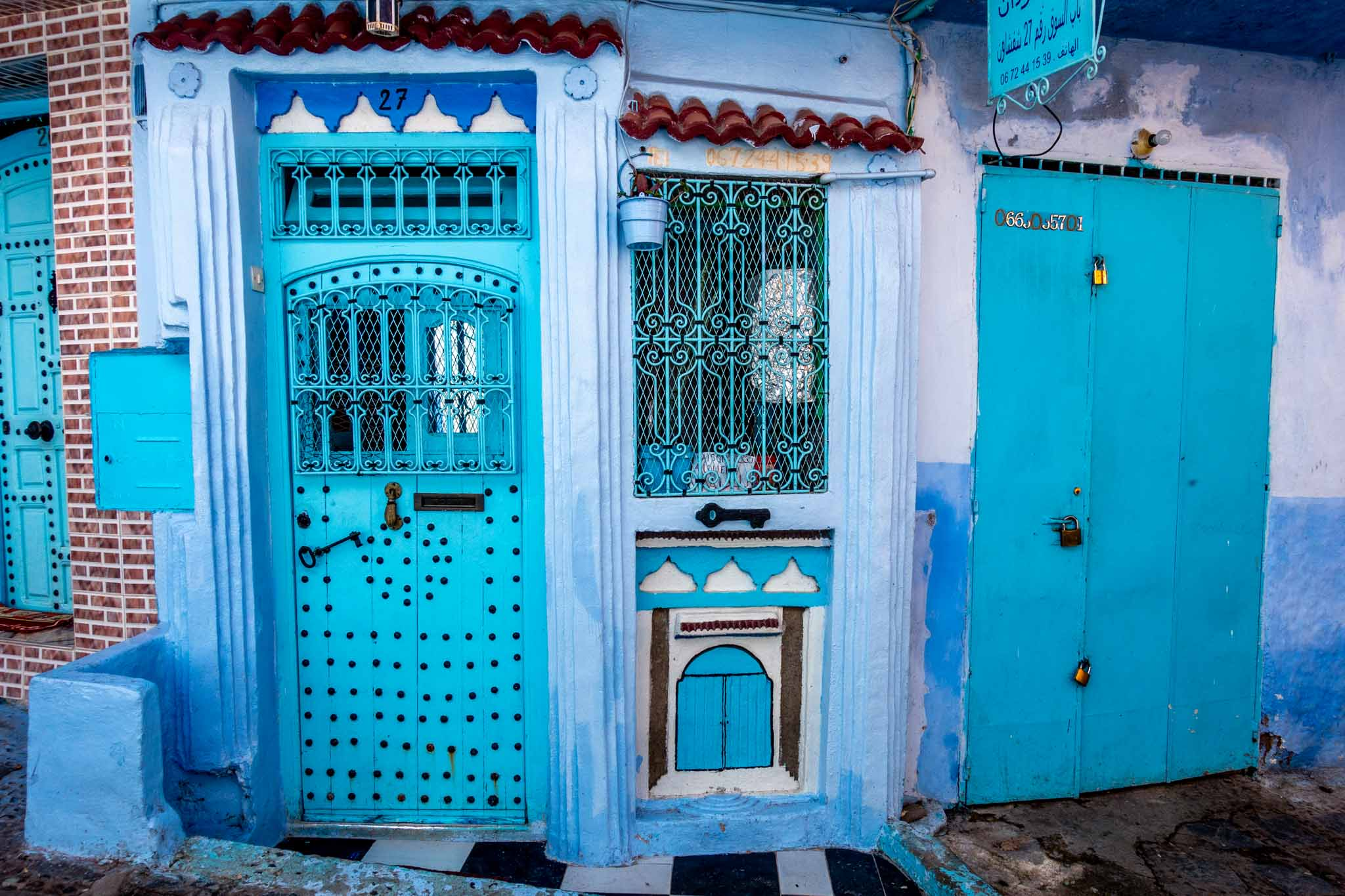 Turquoise doors decorated with turquoise wrought iron