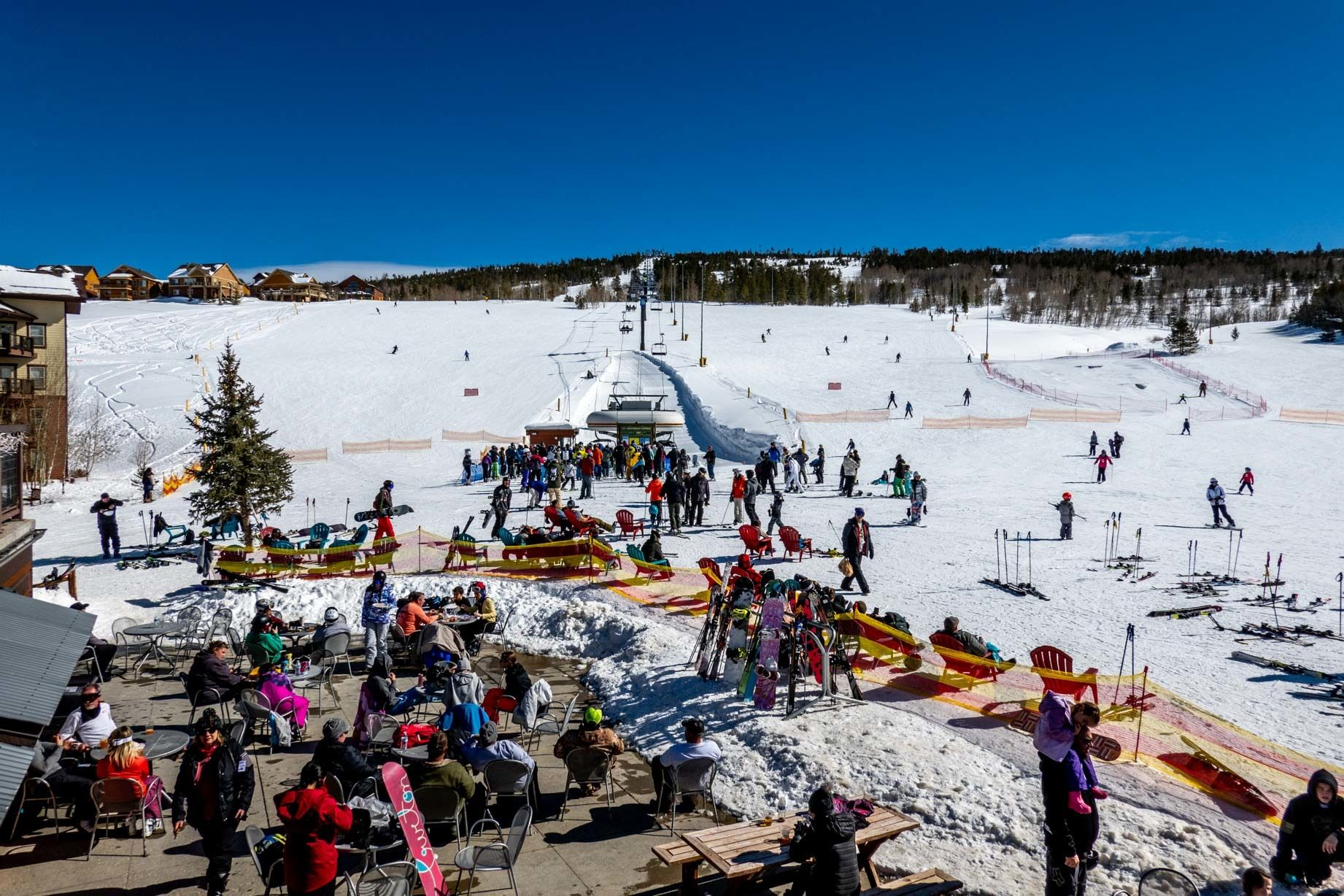 People at the base of a ski lift