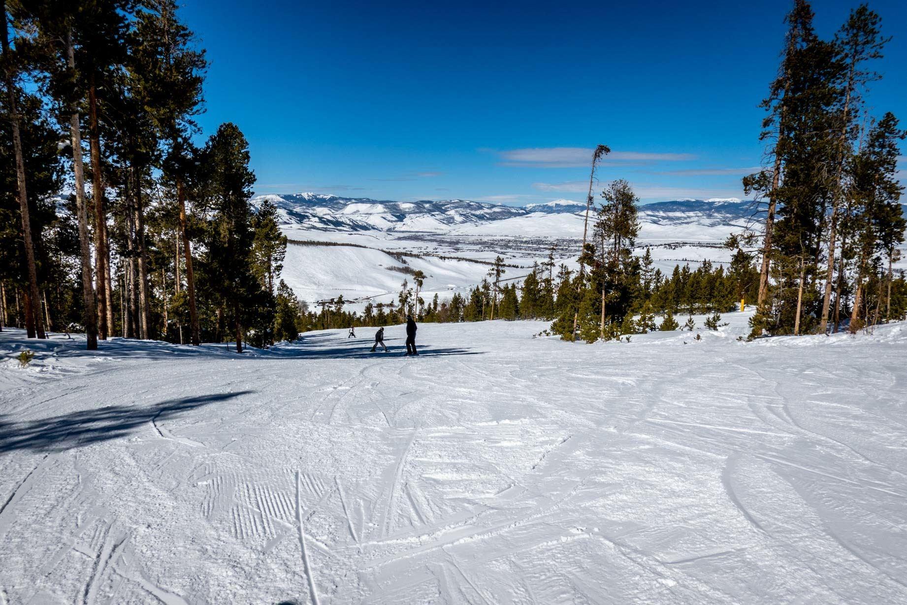 Ski run with people skiing