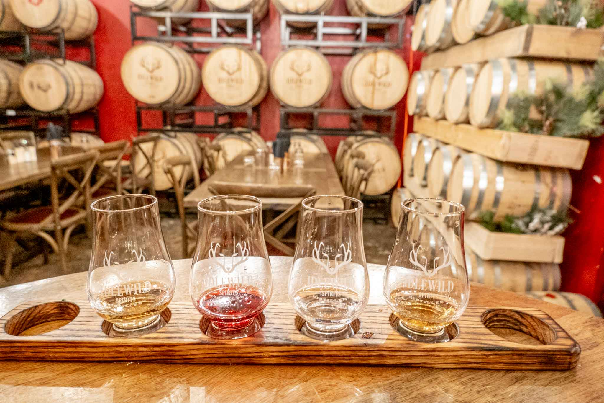 Tasting flight in a room filled with barrels