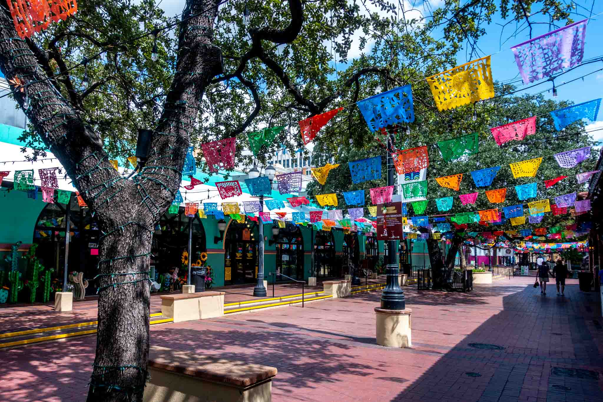 Colorful flags hung across a pedestrian walkway