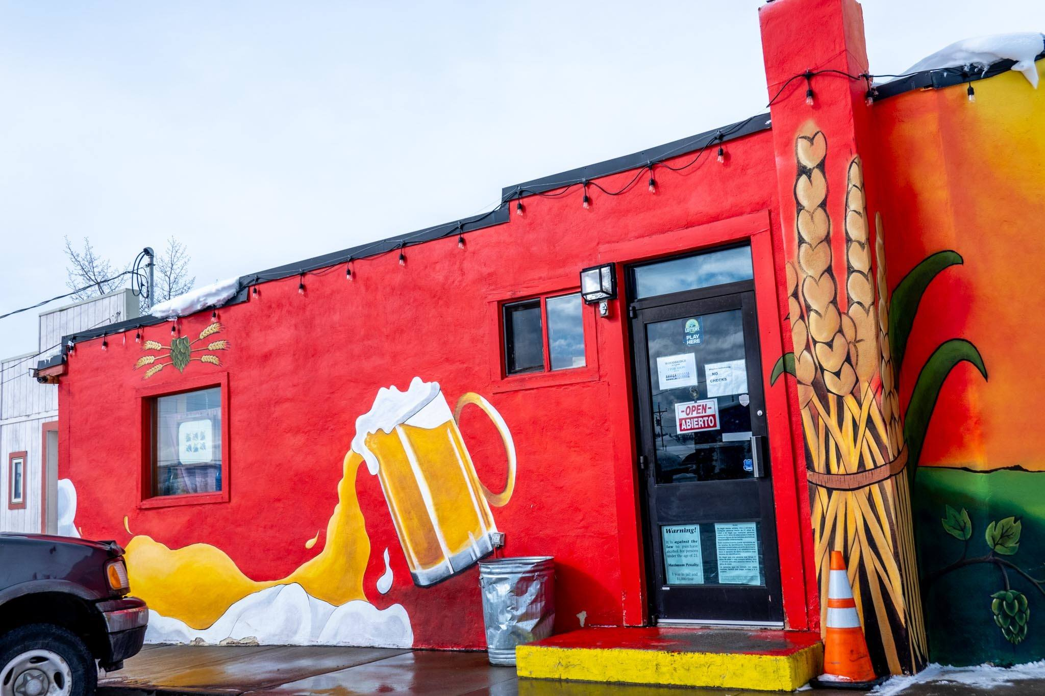 Beer mug and grains painted on side of liquor store